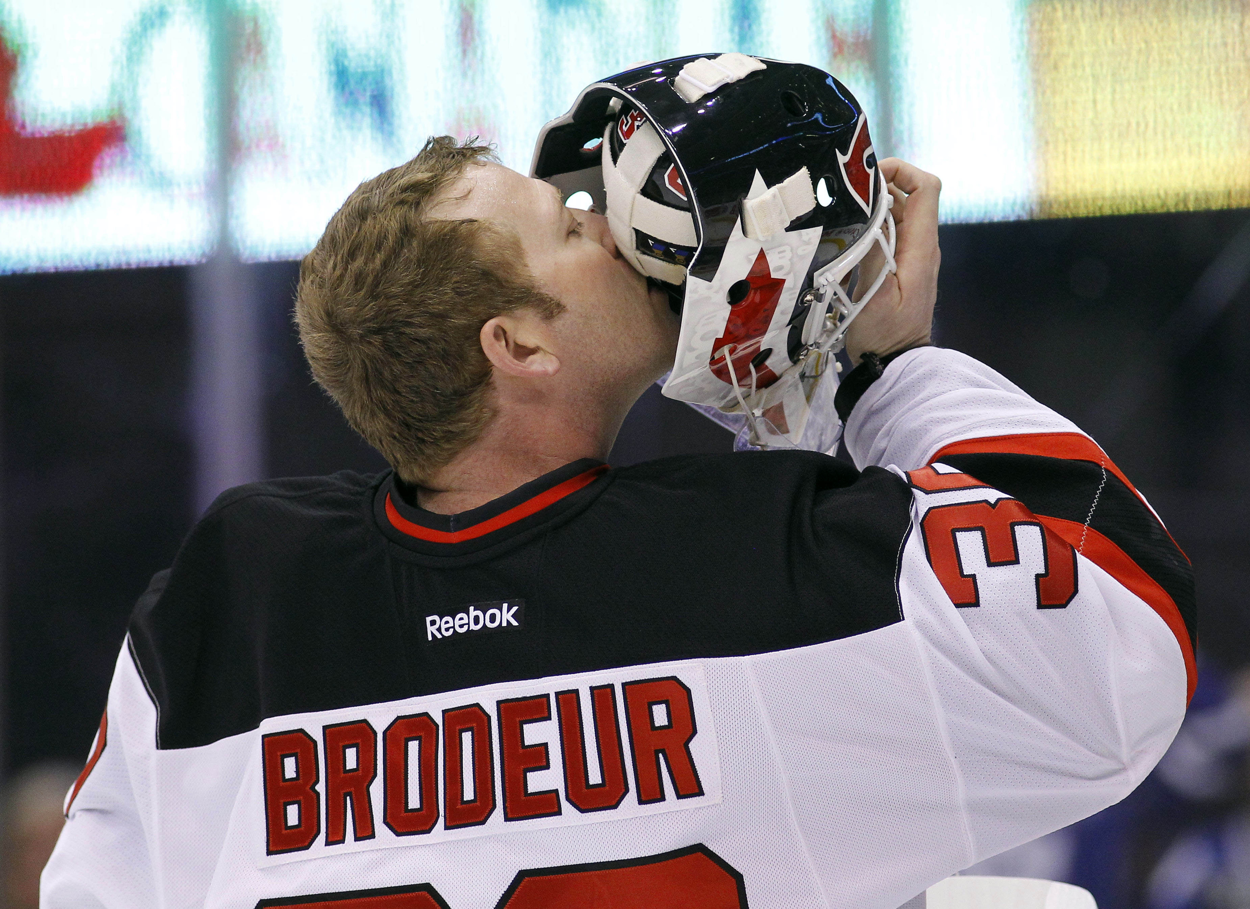 Martin Brodeur won't be kissing the mask on the NHL 14 cover should he win, but it's still a good photo anyway.