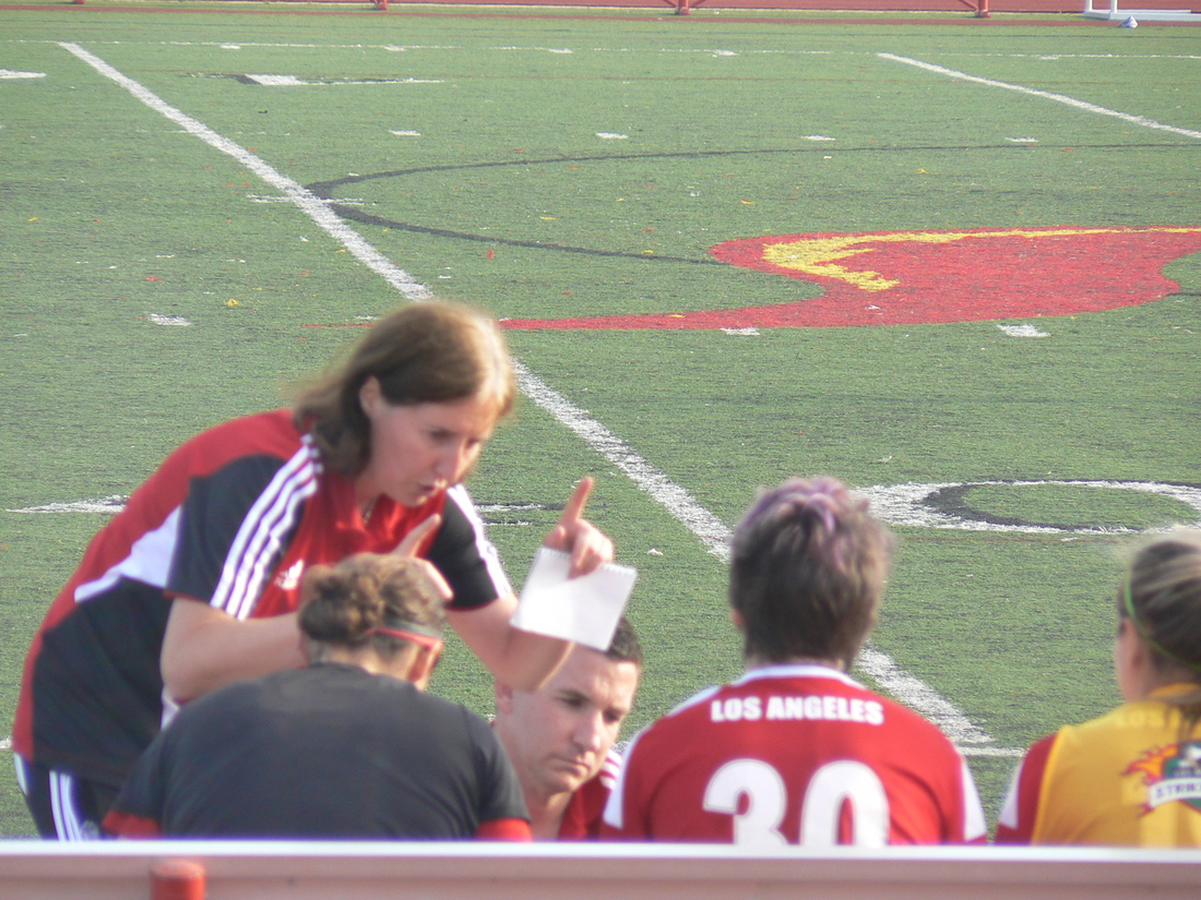 Coach Kevins, directing her team
