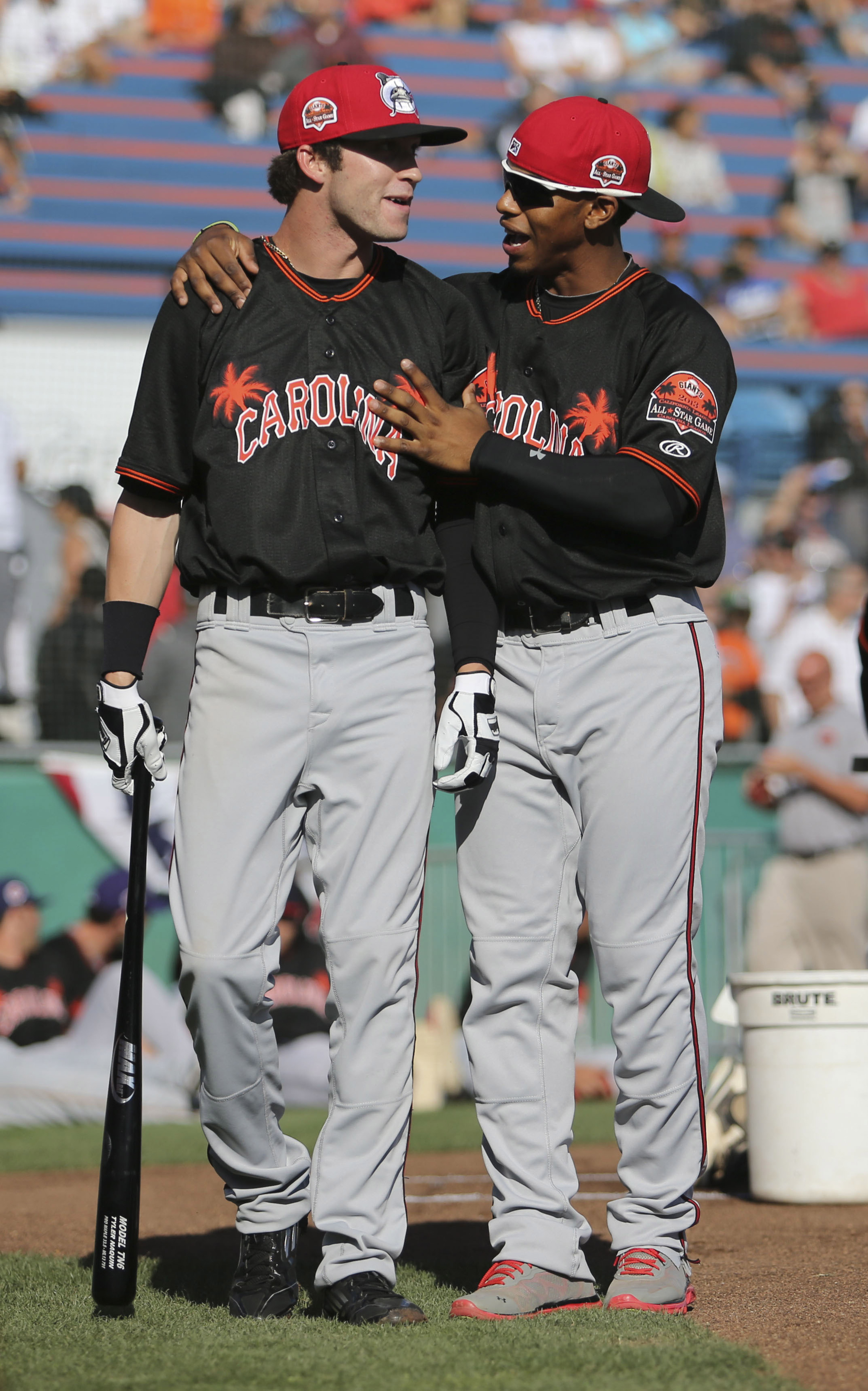 Tyler Naquin (left) and Francisco Lindor (right)