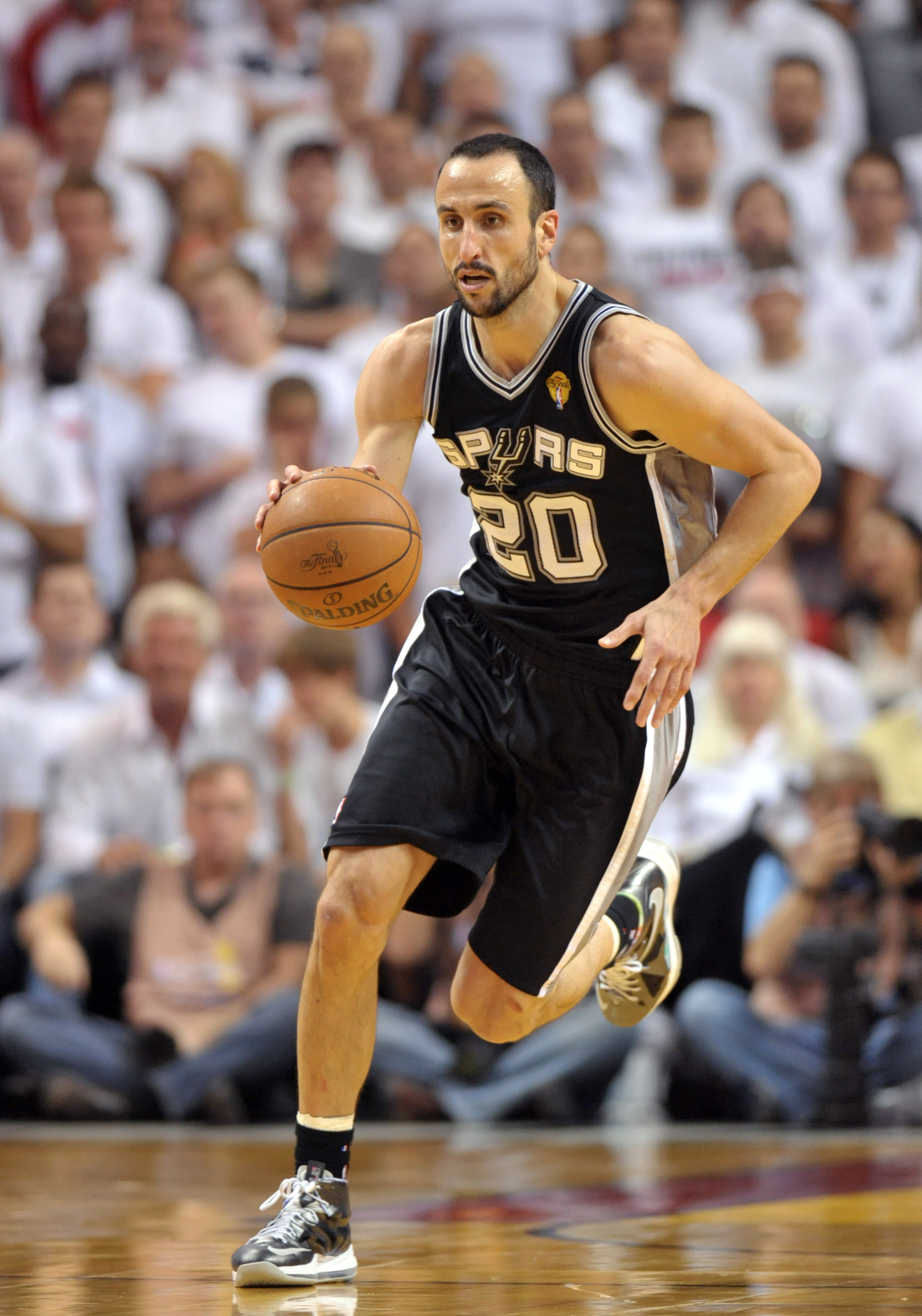 Manu Ginobili agrees to 2-year contract to stay with Spurs