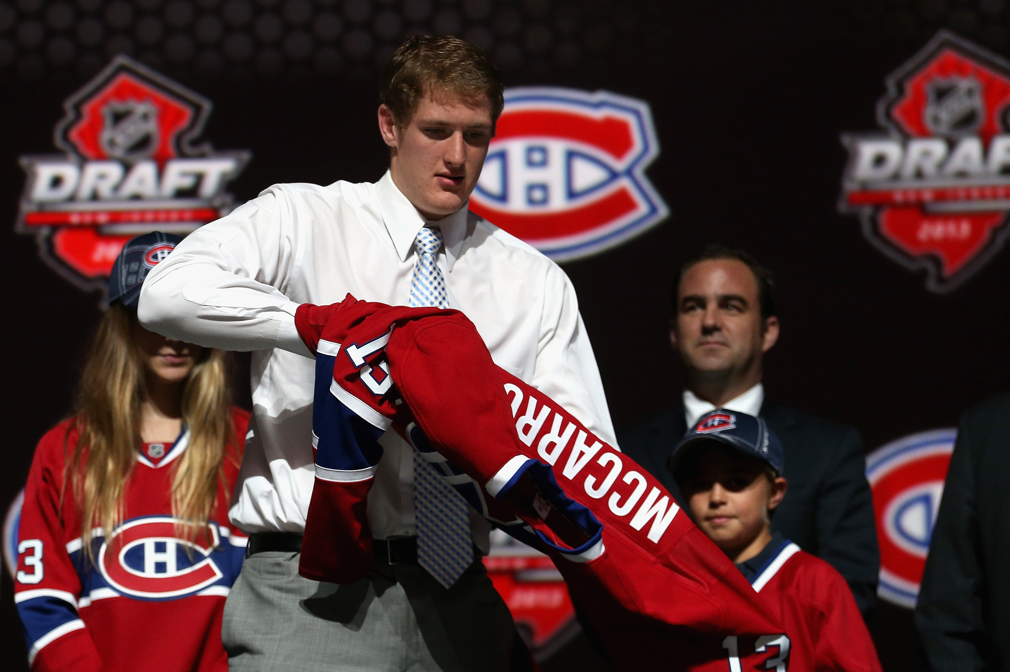 Montreal draft pick Michael McCarron, seen here putting on a Canadiens jersey at the 2013 NHL Draft in Newark, appears destined to wear a London Knights sweater in 2013.