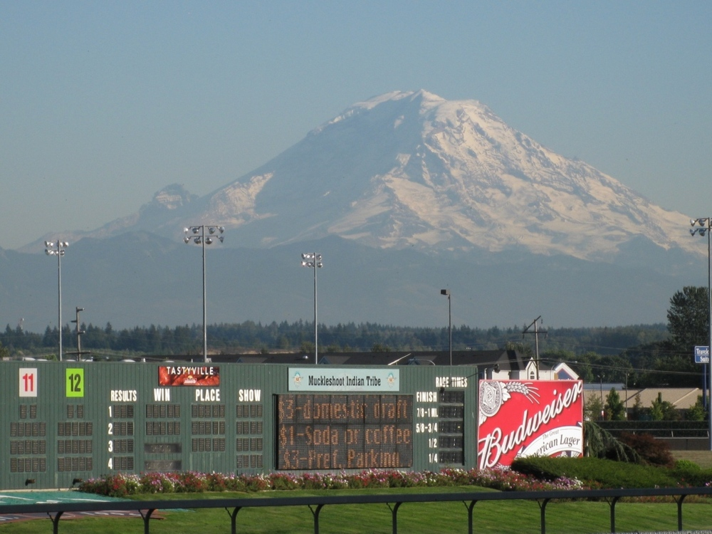 Mt. Rainier looms over Emerald Downs on a sunny, clear day in the Pacific Northwest