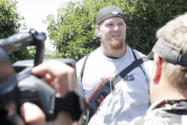 Tony Bergstrom speaks to media as he arrives at the Napa Valley Marriott for 2012 Raiders training camp