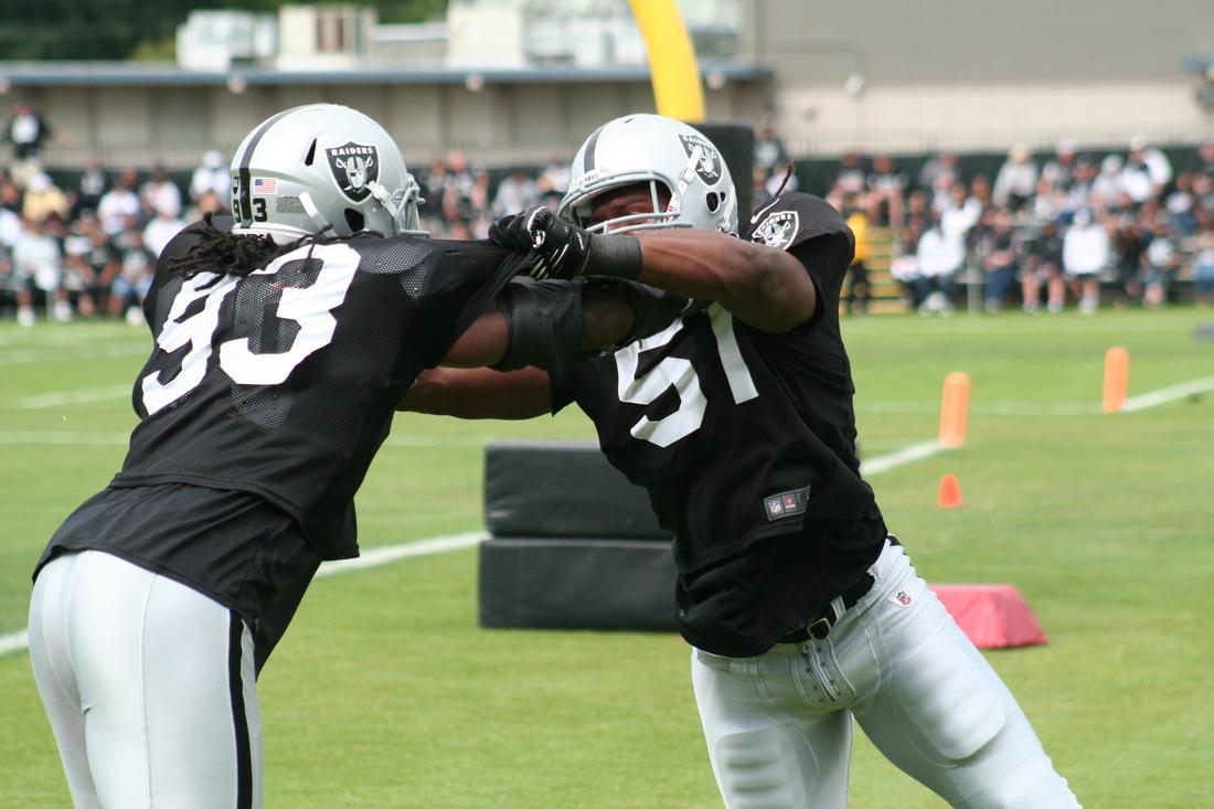 Jason Hunter and David Bass working in defensive line drills at Raiders training camp
