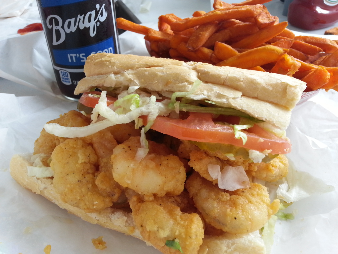 Fried shrimp po-boy at Parkway Bakery in New Orleans, Louisiana. Fully dressed (mayo, lettuce, pickles and tomato) with a side of sweet potato fries and a Barq's root beer.