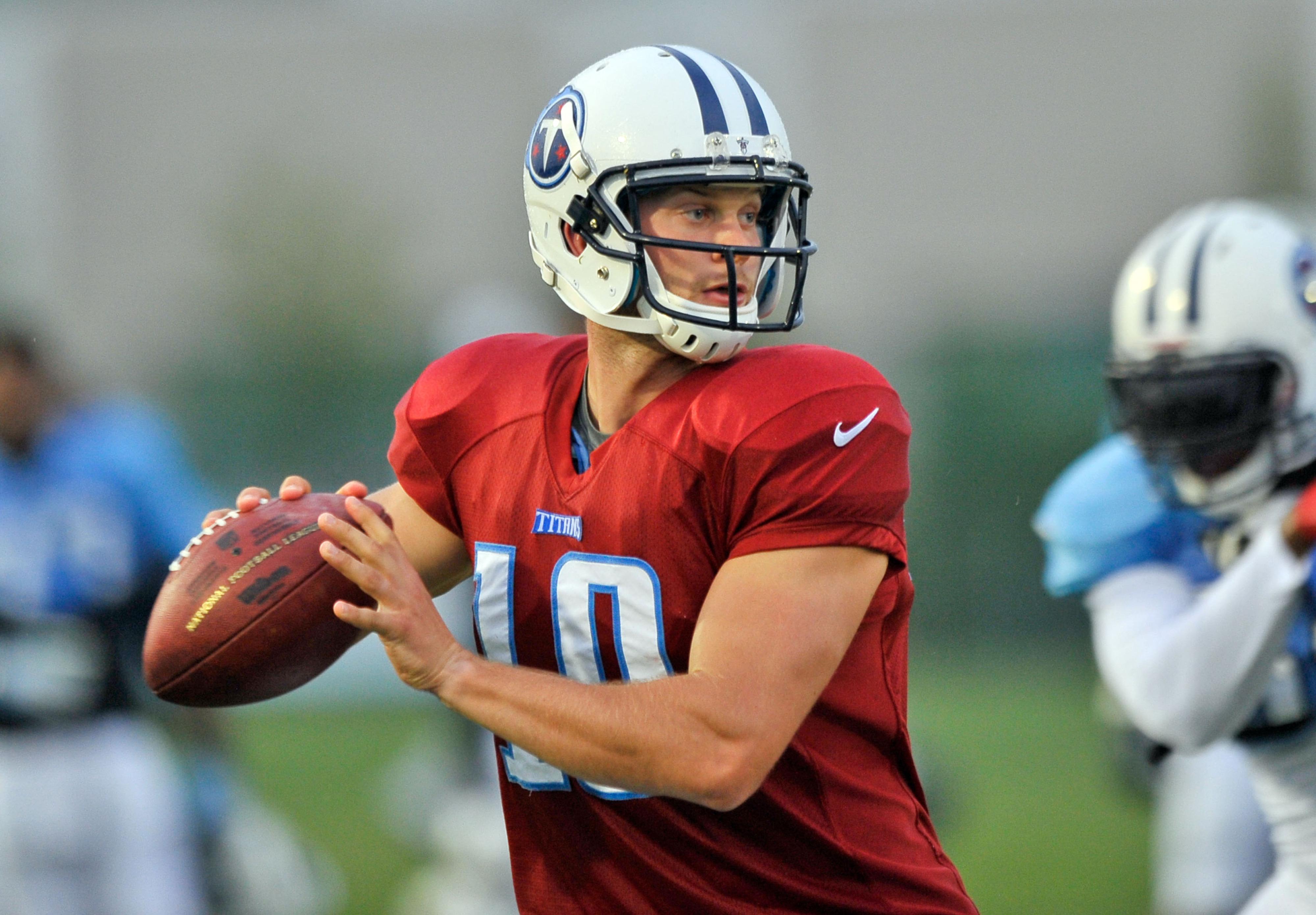 Titans Quarterback Jake Locker throws a pass during training camp