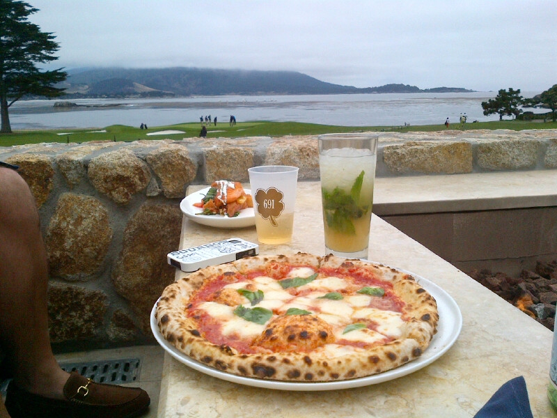 Margarita pizza with a big side of mint julep, overlooking 18th at Pebble Beach.