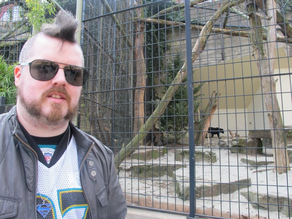Stevie, with hair that drips sex, standing in front of an actual jaguar.