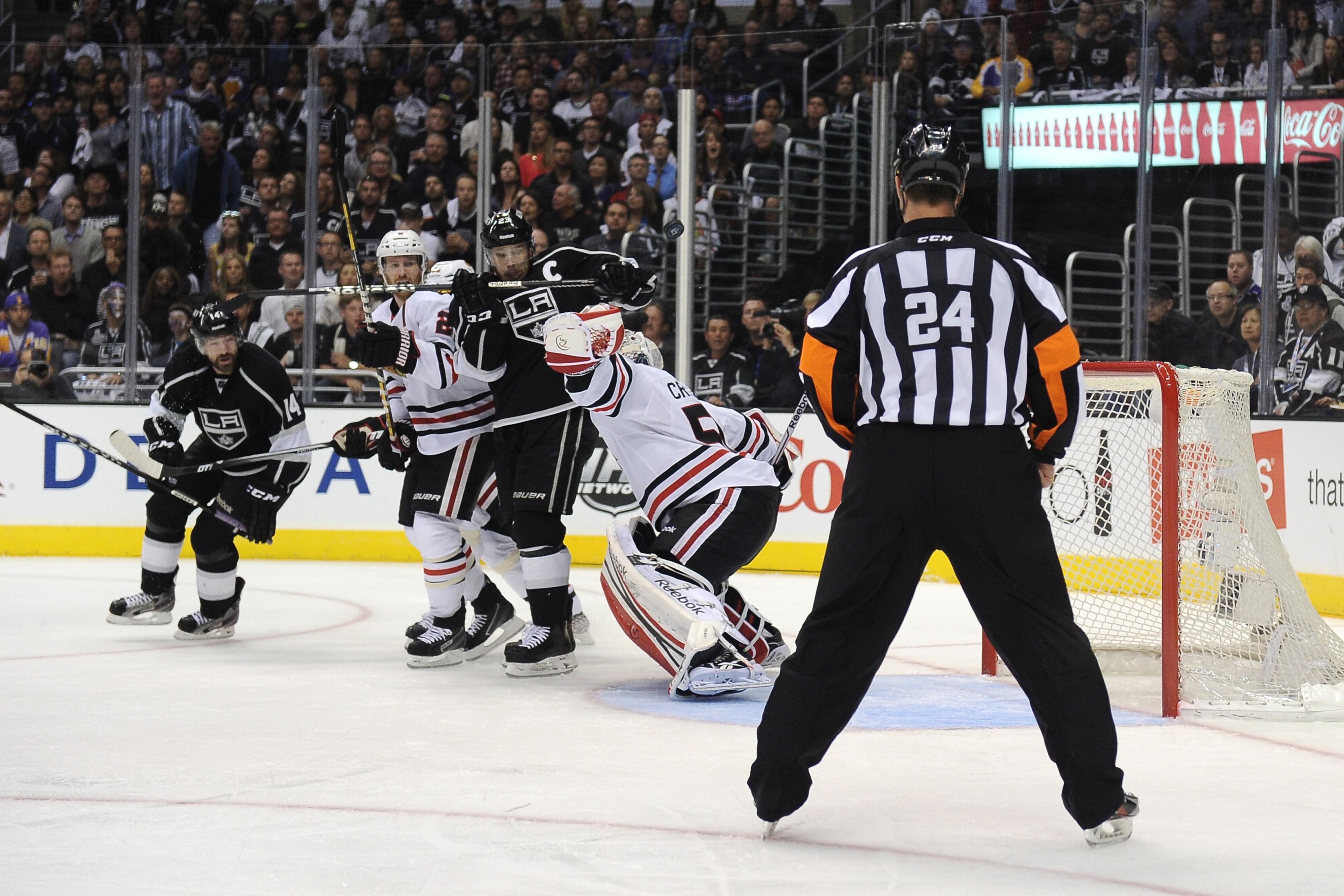 Stephen Walkom eyes Dustin Brown with suspicion...and fear