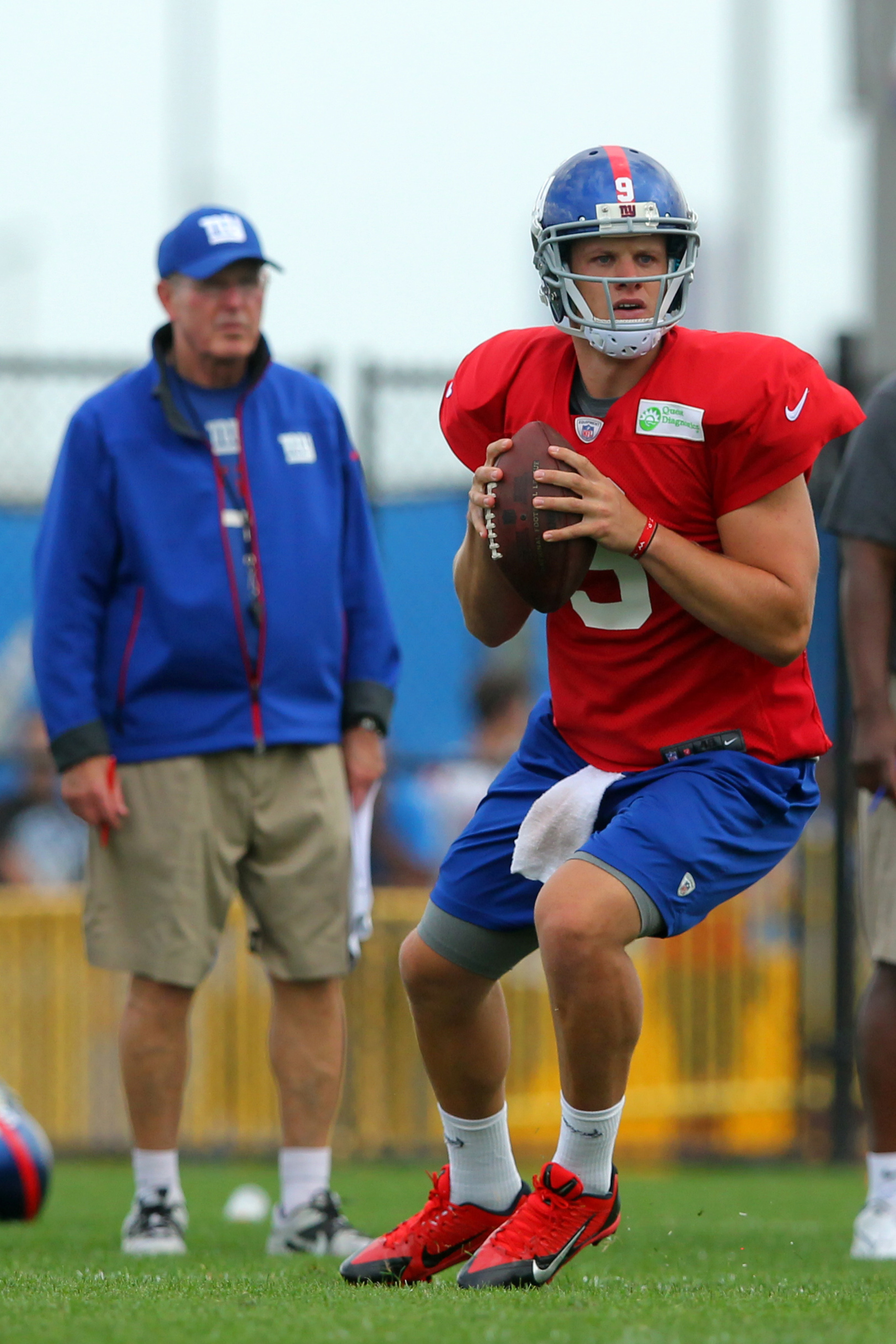 Ryan Nassib with tom Coughlin watching closely