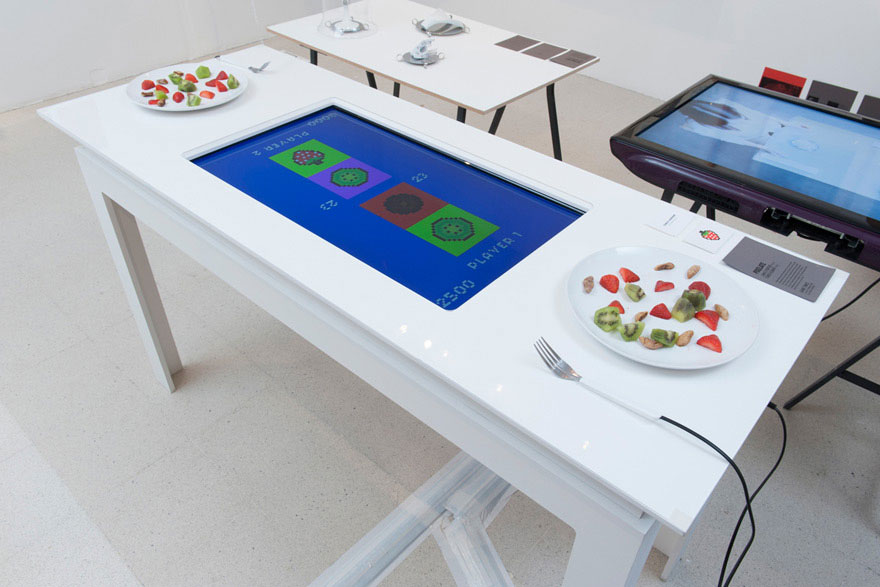 Interactive dining table gamifies a meal for two