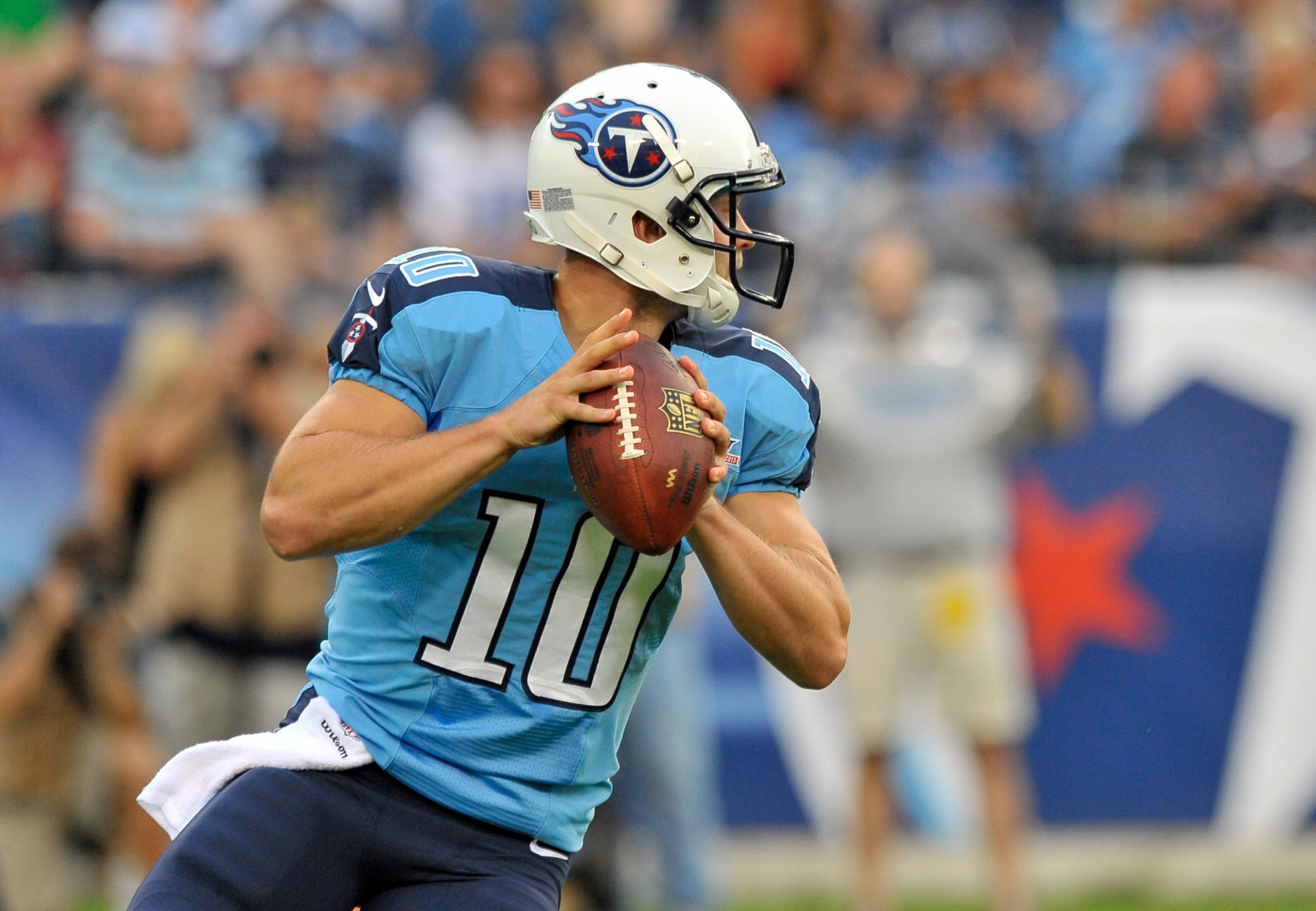 Titans quarterback Jake Locker drops back to throw a pass at LP Field