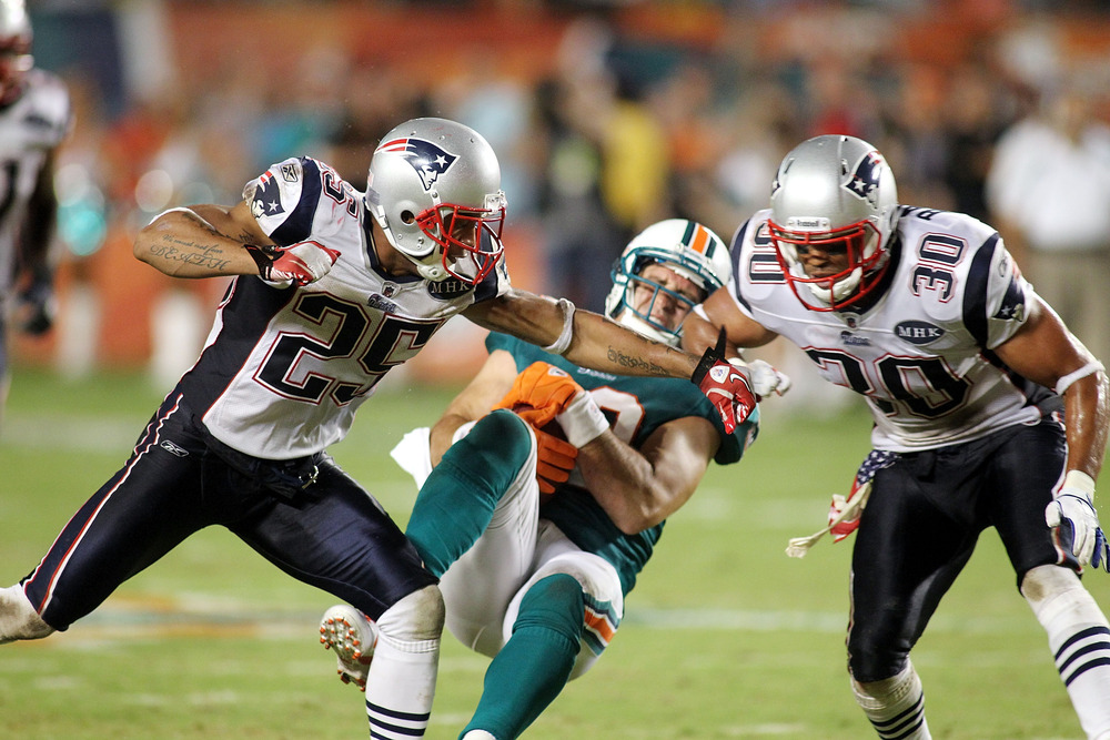 Josh Barrett (30) went on to play for the Broncos and Patriots in the NFL.