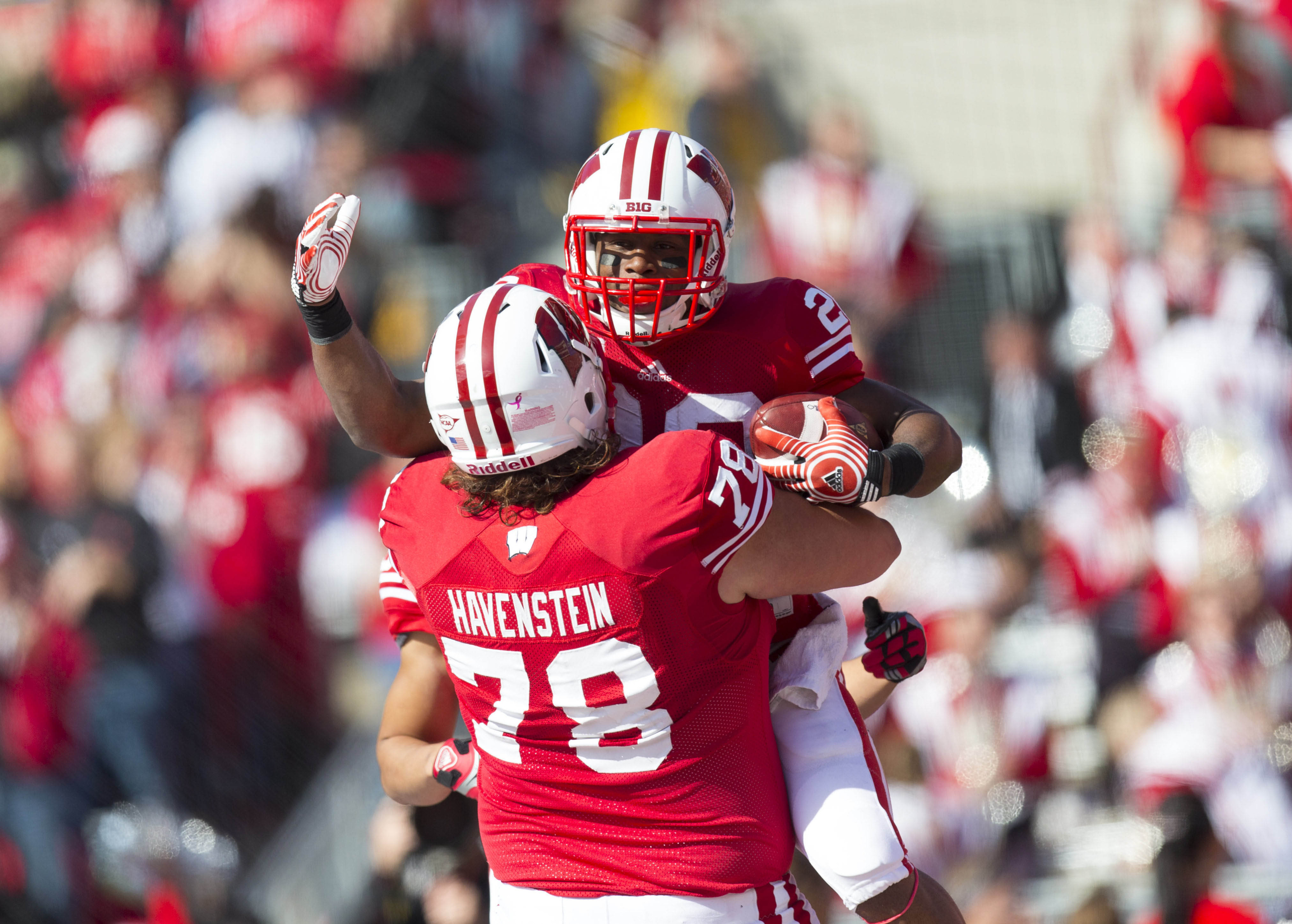 James White (leaping) gave the Badgers plenty to celebrate on Saturday.