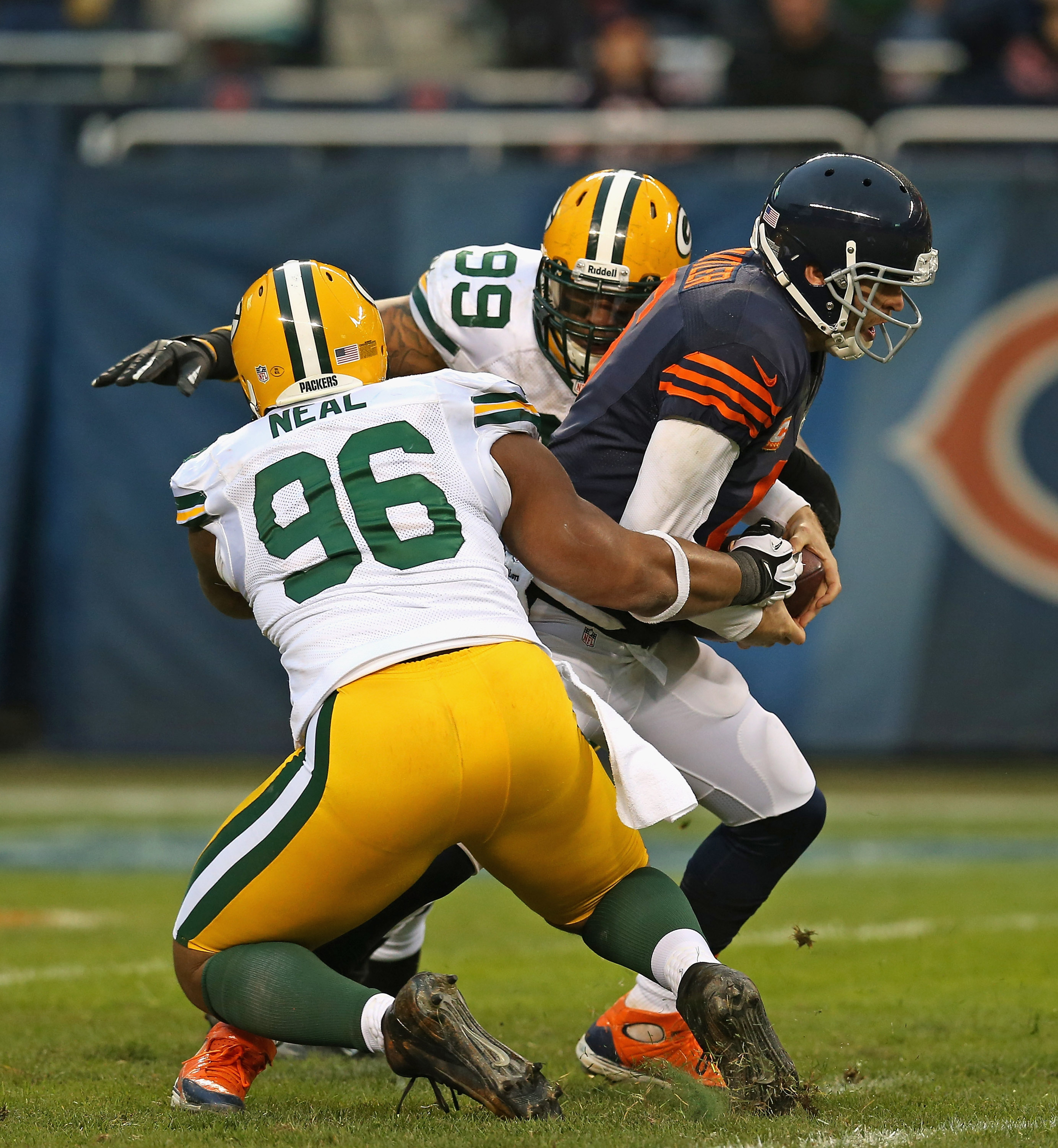Jay Cutler (6) of the Chicago Bears is sacked by Mike Neal (96) and Jerel Worthy (99) of the Green Bay Packers during a 2012 game.