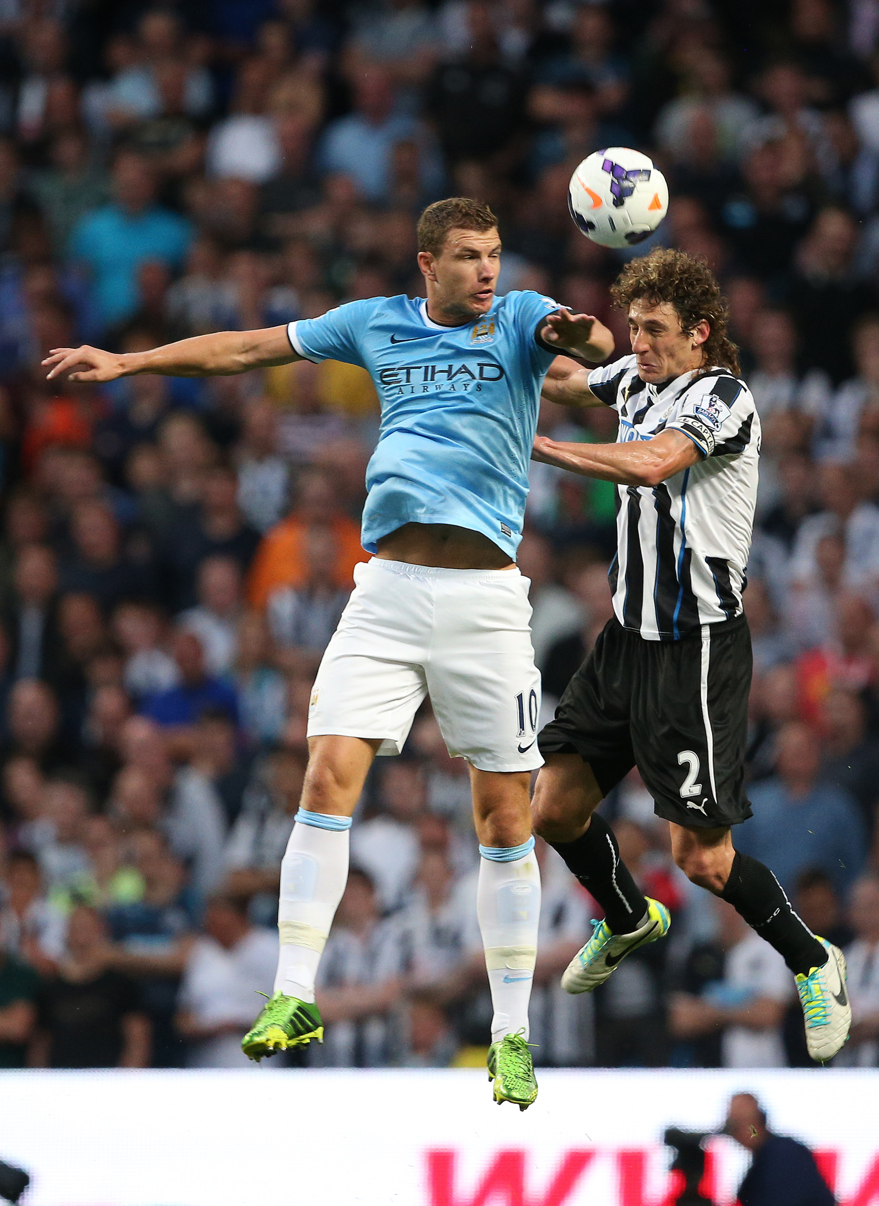 It might be hard to tell here, but Edin Dzeko is really very happy.