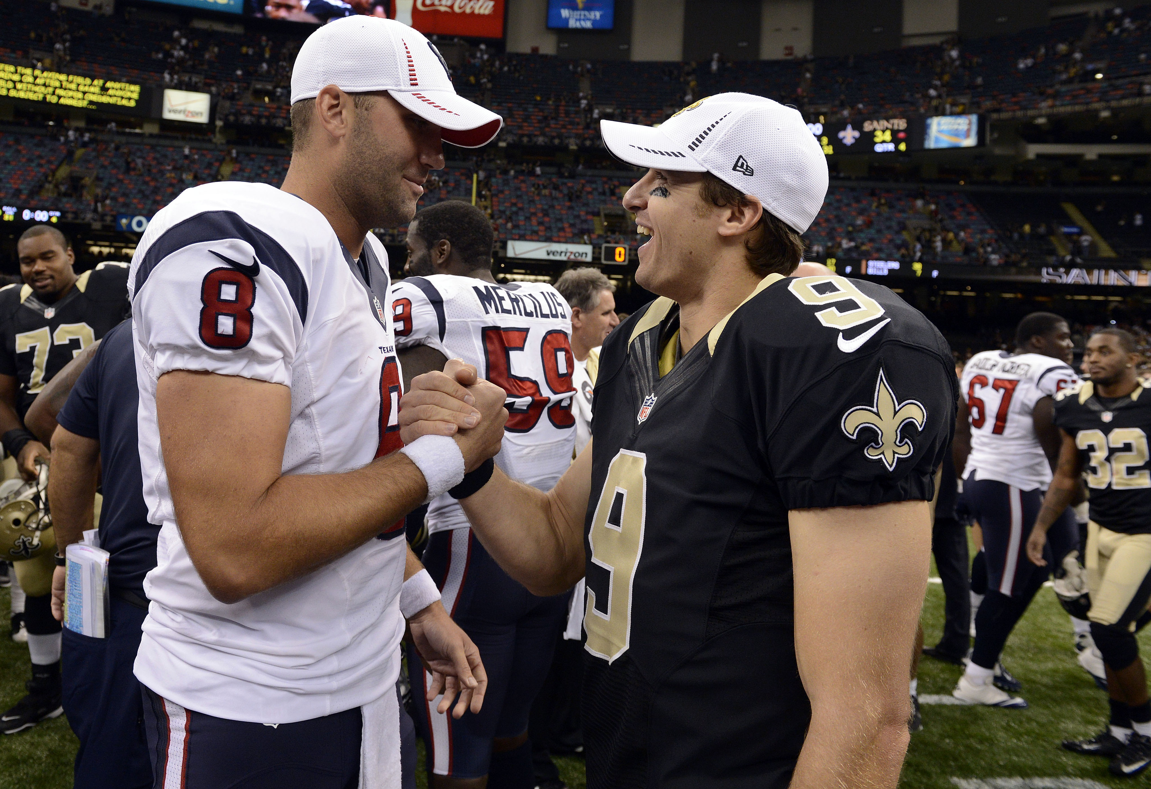 A future Hall of Famer and Drew Brees share a post game laugh.