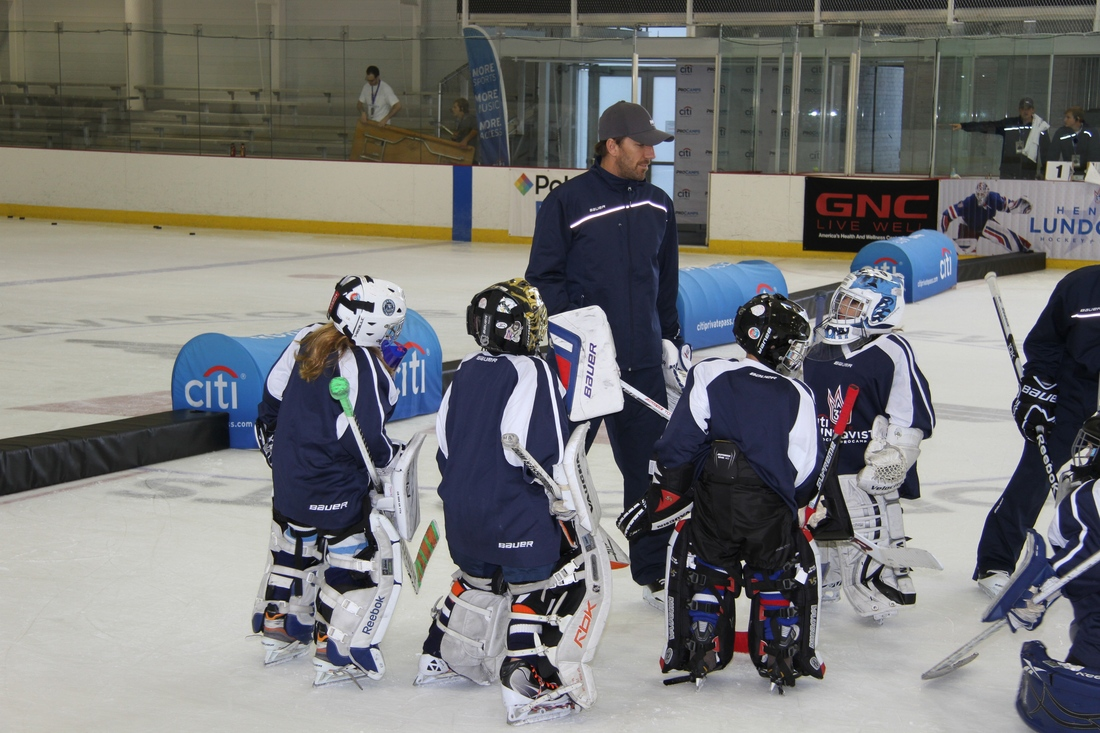 Henrik Lundqvist talks to some of the goalies in his camp.