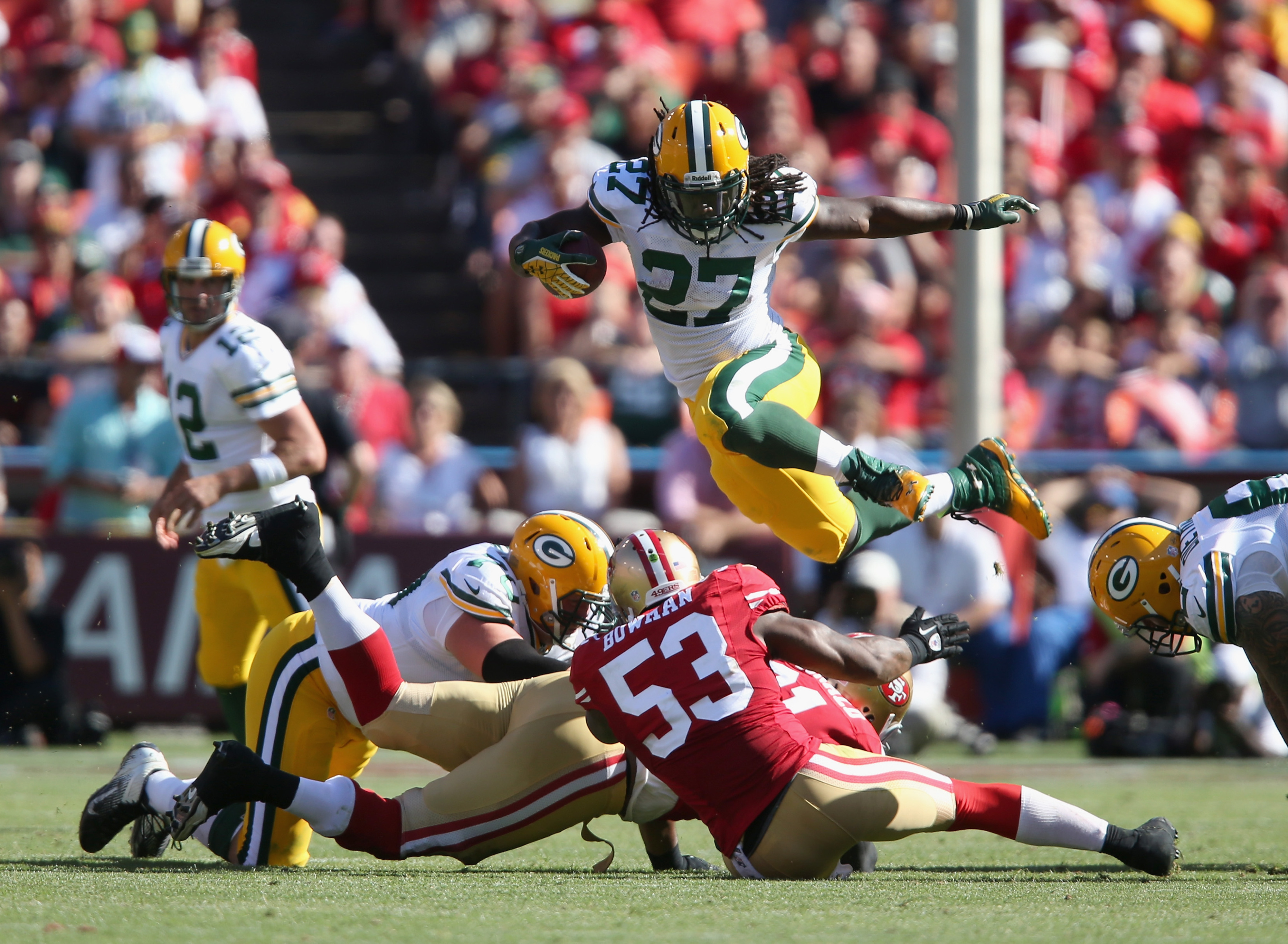 Eddie Lacy (27) hurdles over a pile during Sunday's game against the 49ers