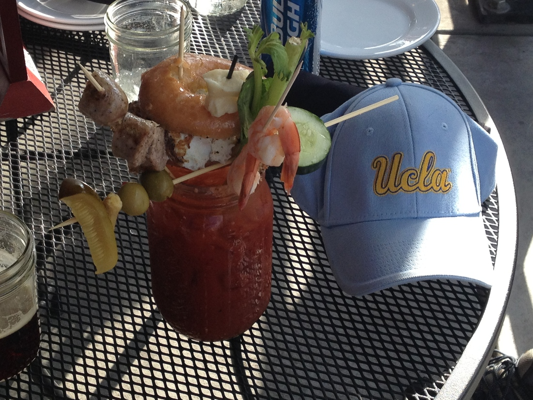 Breakfast in Lincoln.  30 ounce bloody mary with shrimp, sausage, pickle, olive, celery and a donut burger with a meat and egg patties.
