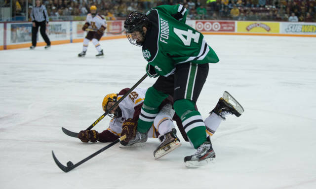 You might think that player is laying down, but Derek Forbort is just that tall.