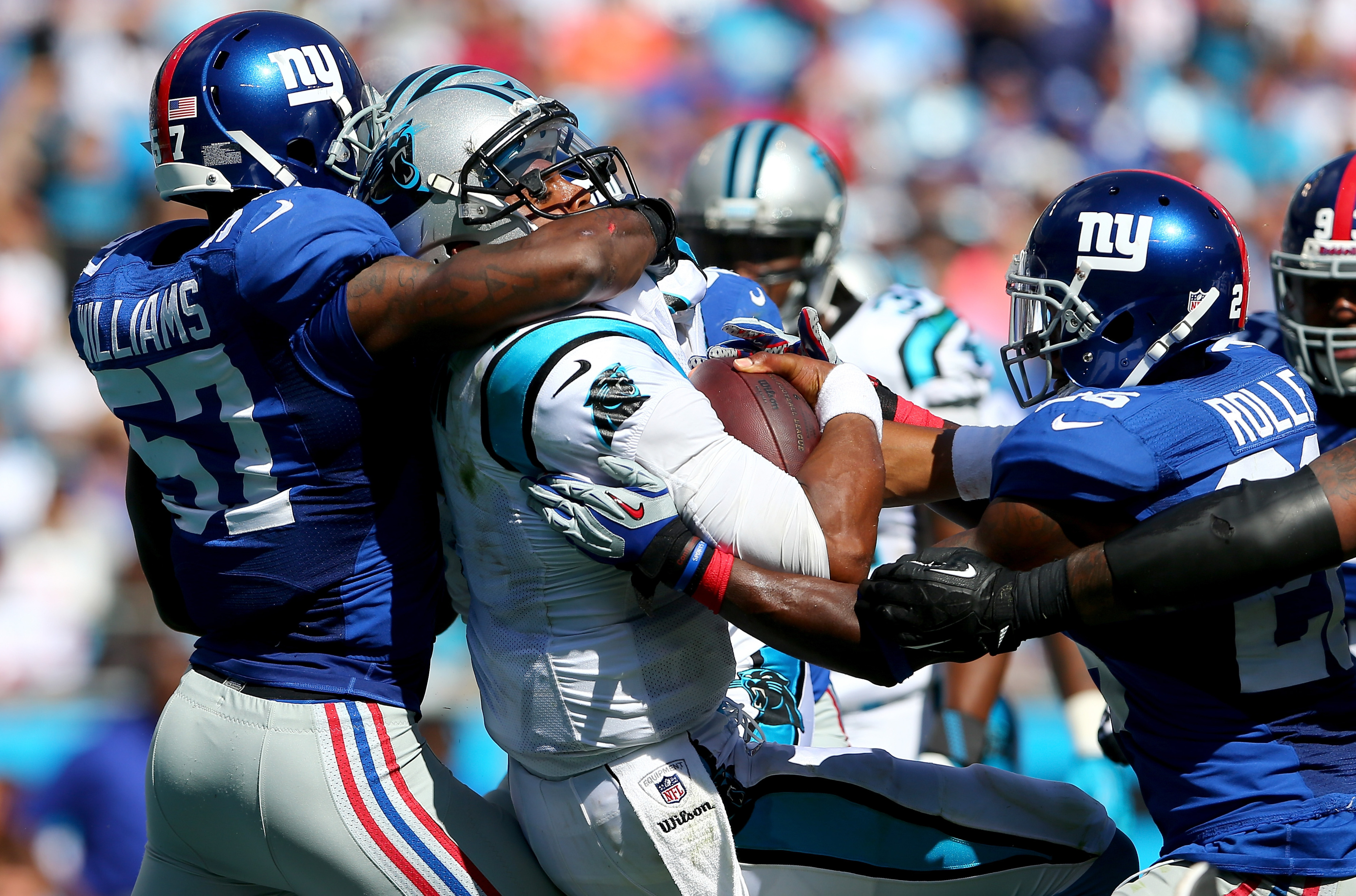 Cam Newton overpowers Jacquian Williams to score a touchdown on Sunday.