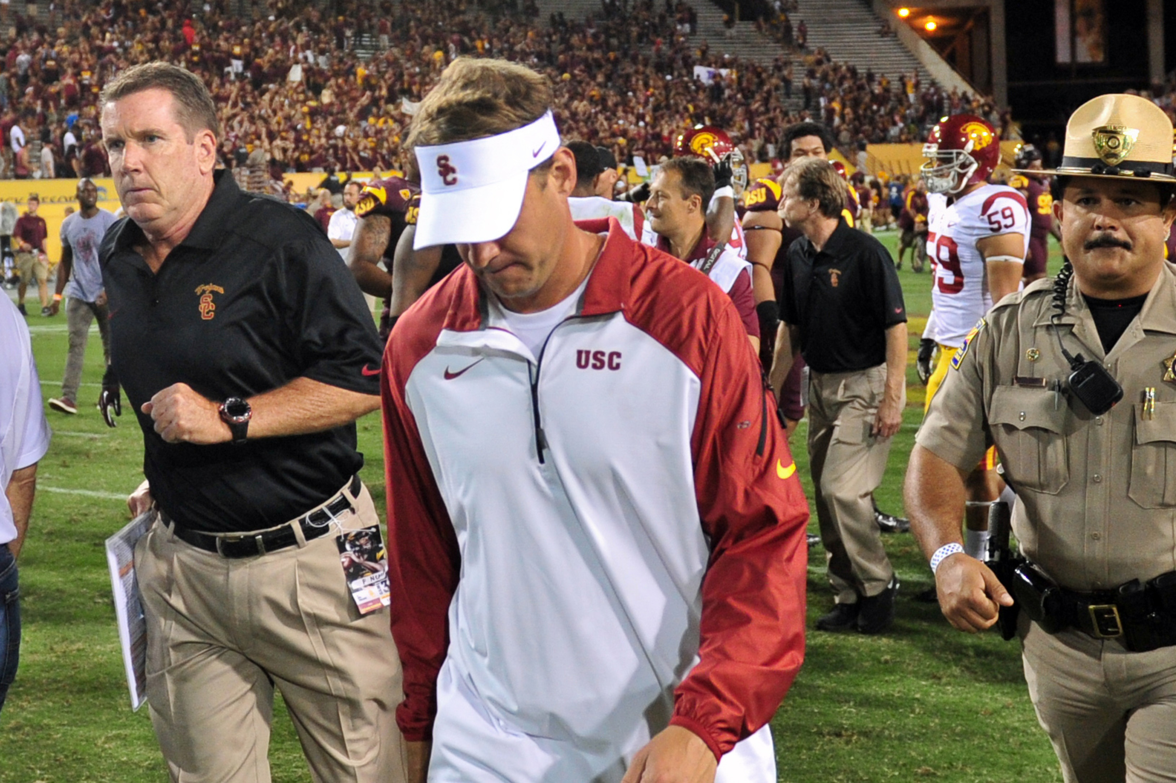 This is the last time we'll see Lane Kiffin in his trademark USC visor.