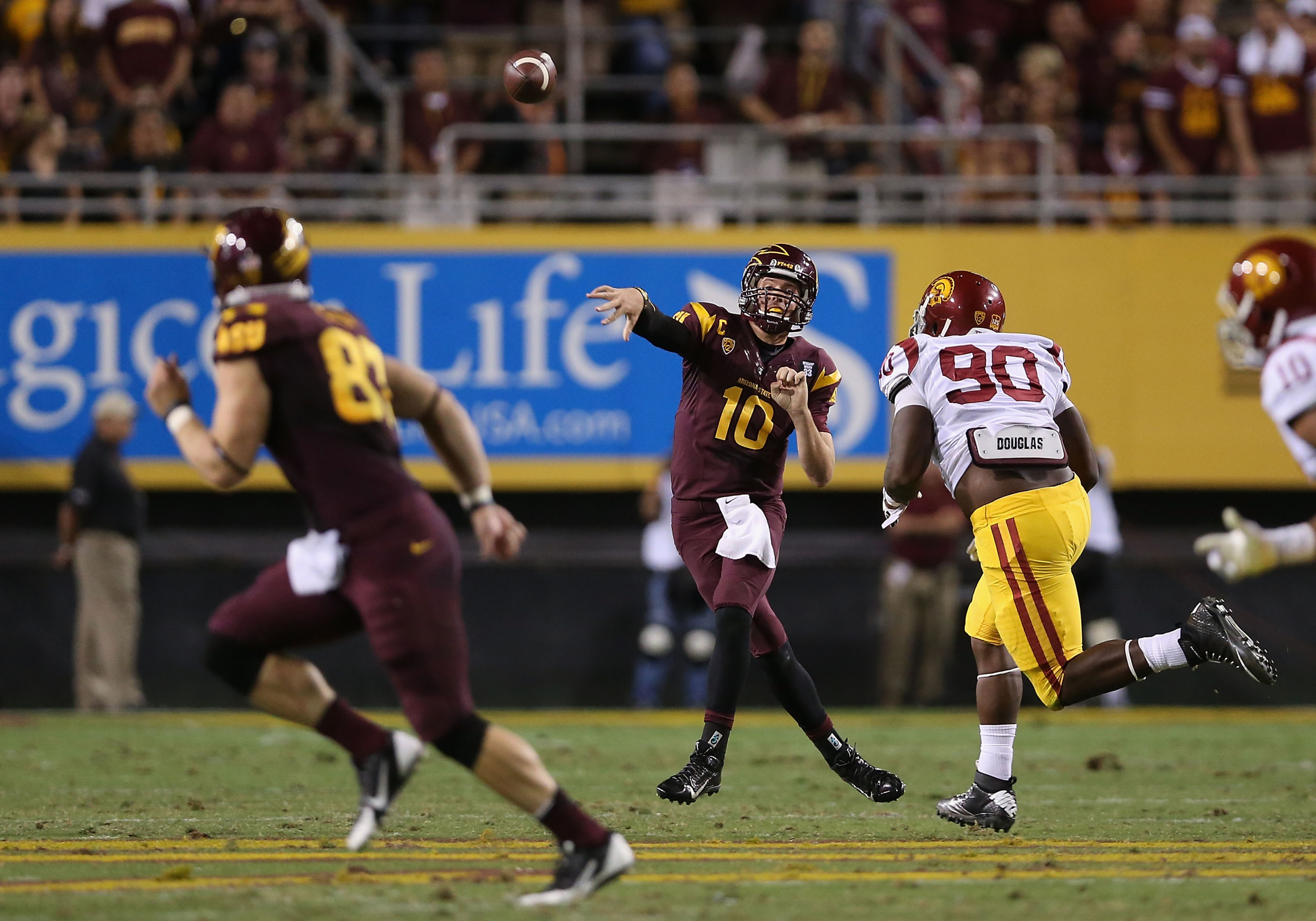 Taylor Kelly found six different receivers and threw for three touchdowns against the Trojans.