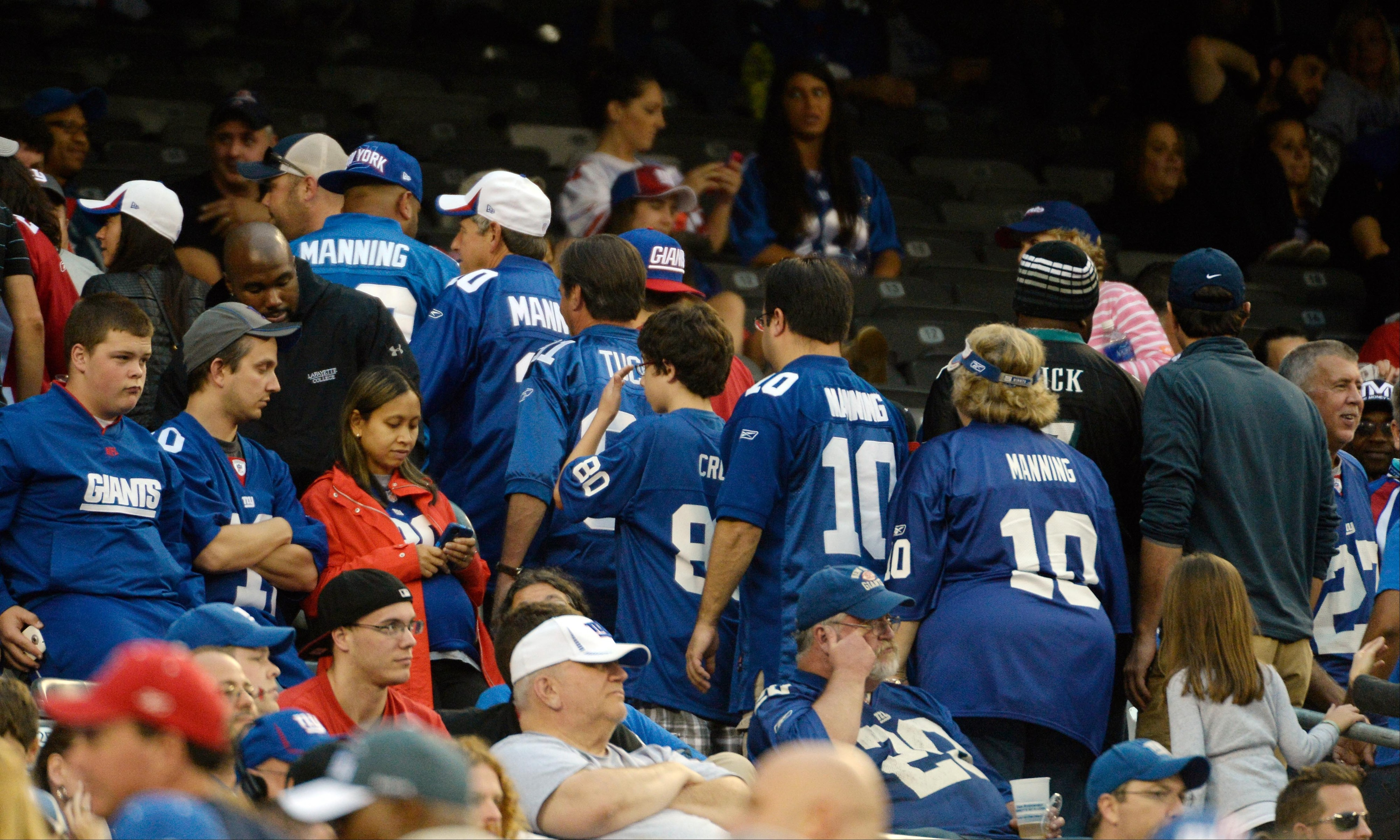 Giants' fans head for the exit in the fourth quarter on Sunday.