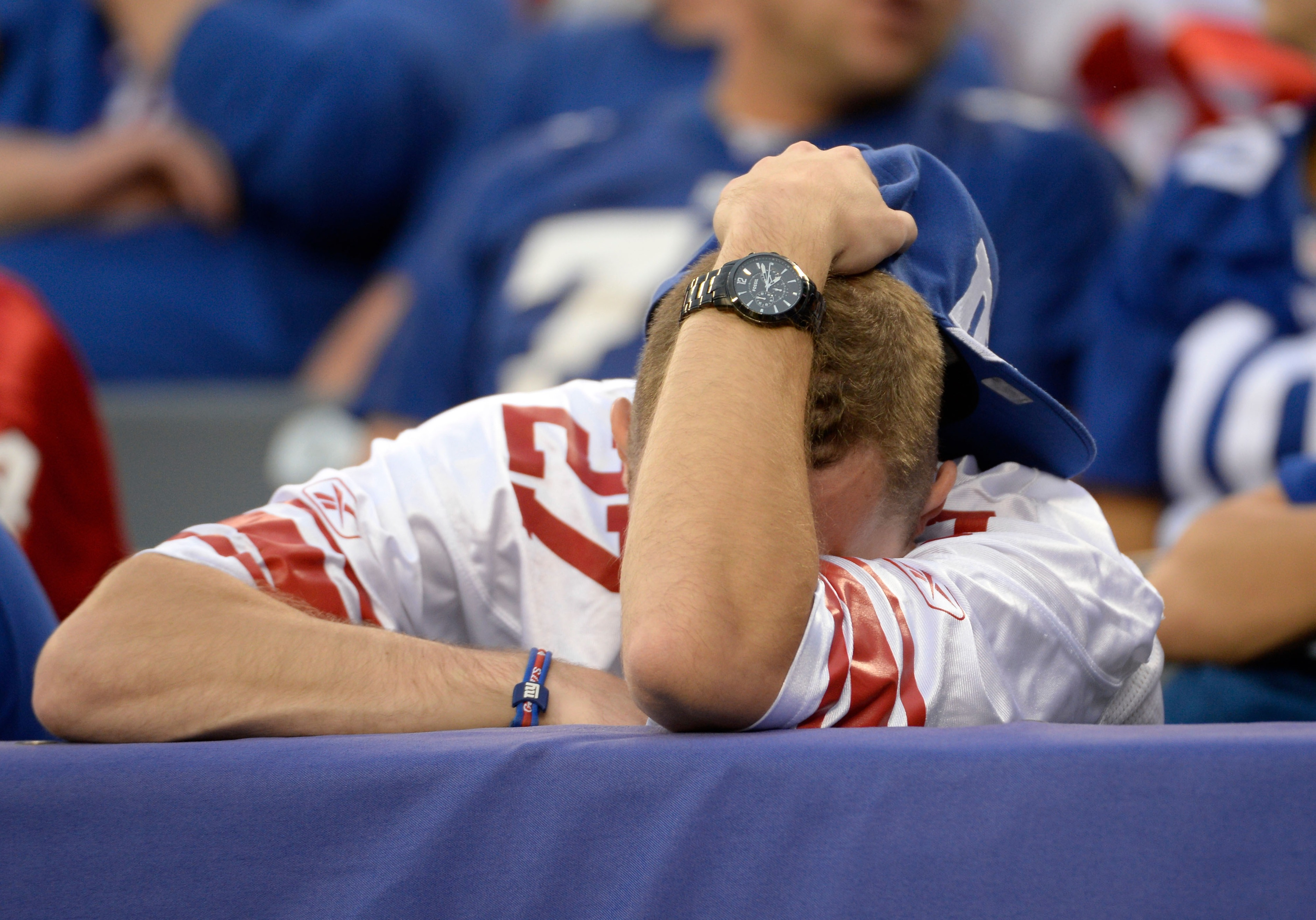 A Giants' fan reacts during Sunday's loss.