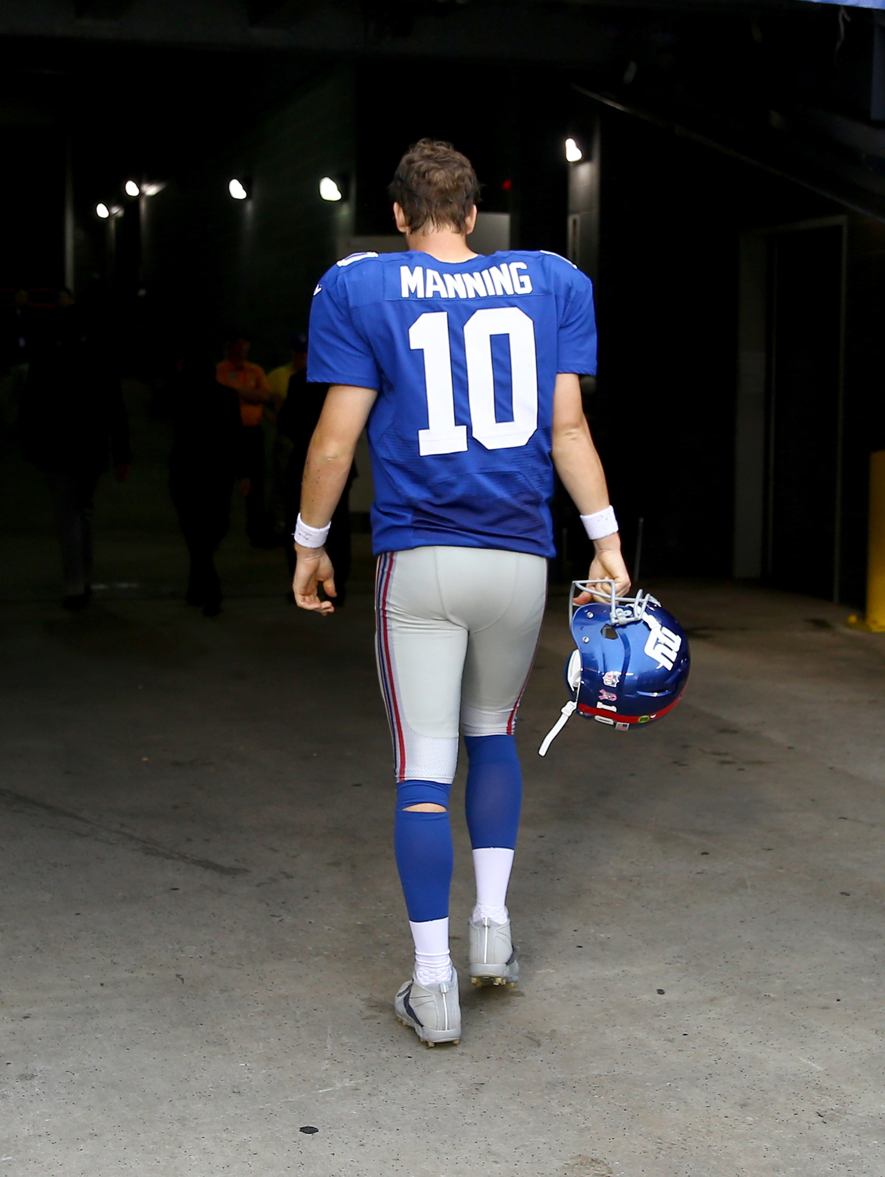 Eli Manning leaves the field following Sunday's game.