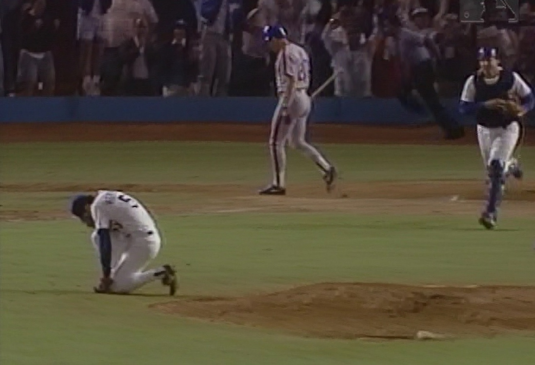 Orel Hershiser celebrates after the final out of Game 7.