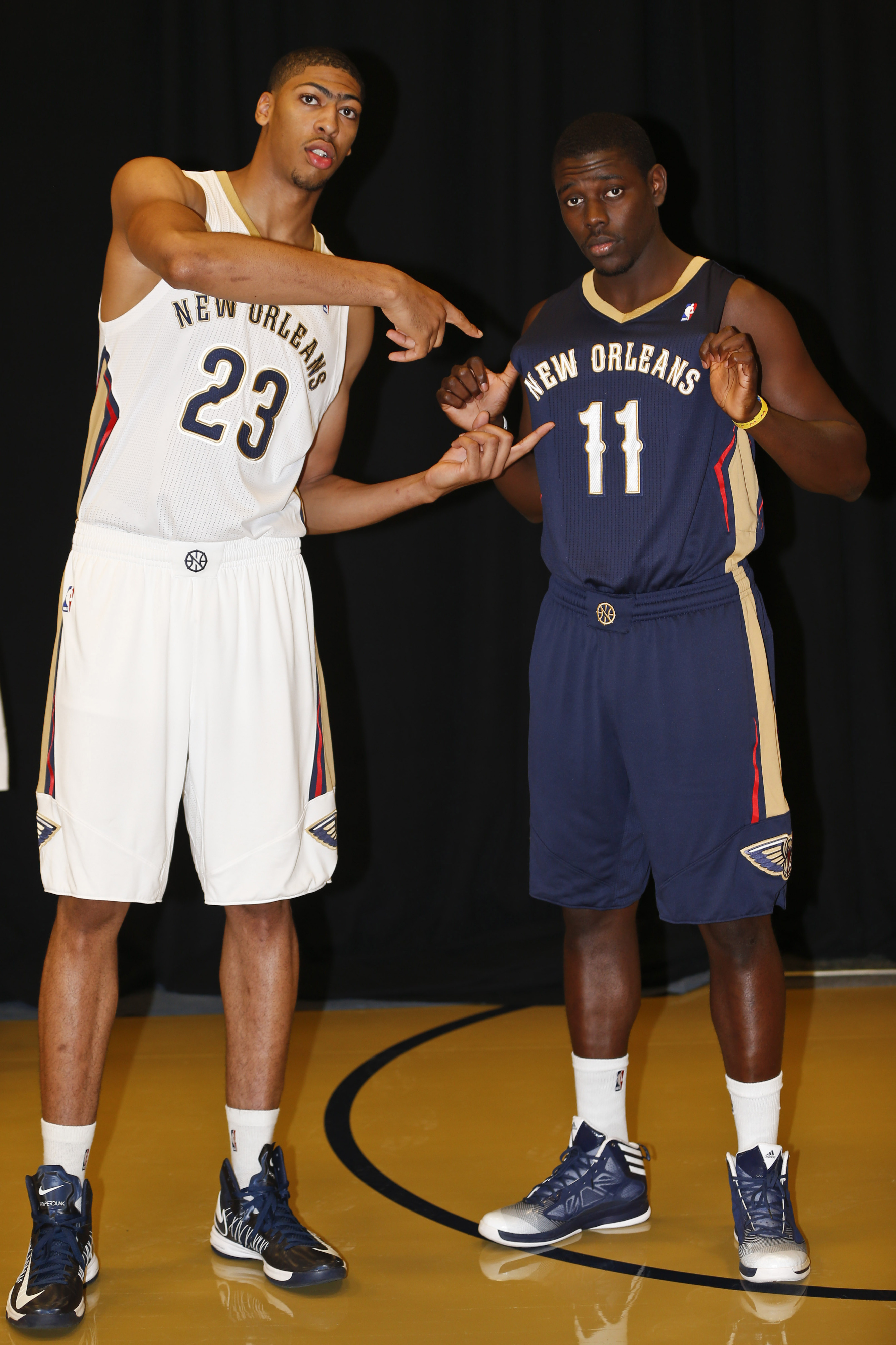 Anthony Davis (L) is the key, but newcomers Jrue Holiday (R), and Tyreke Evans will be critical.