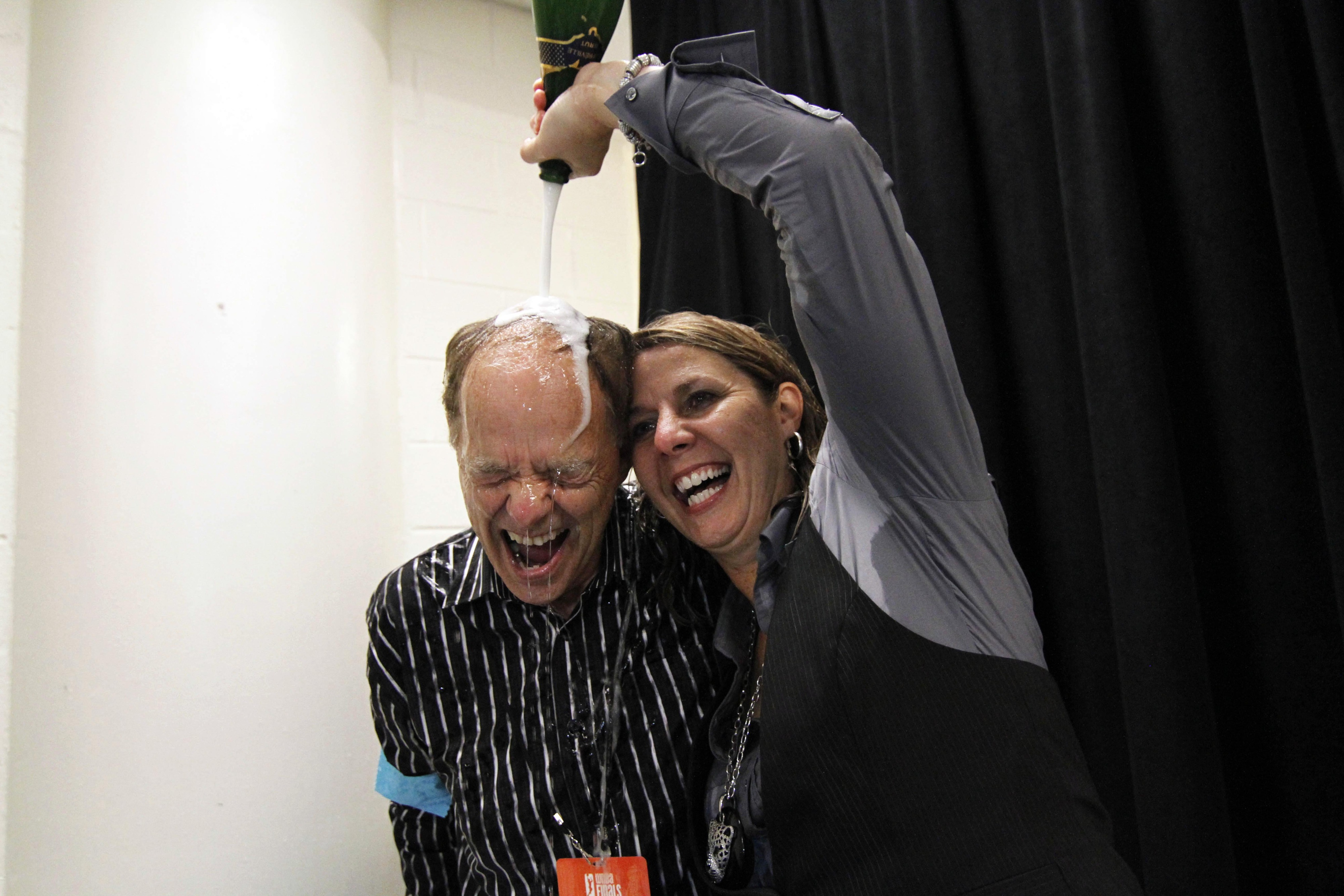 I can only imagine how cold that drink feels on Glen Taylor's bald spot.