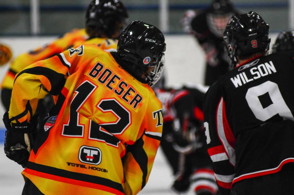 Wisconsin recruit Brock Boeser lines up for a faceoff vs. Team Wisconsin in the Elite League.
