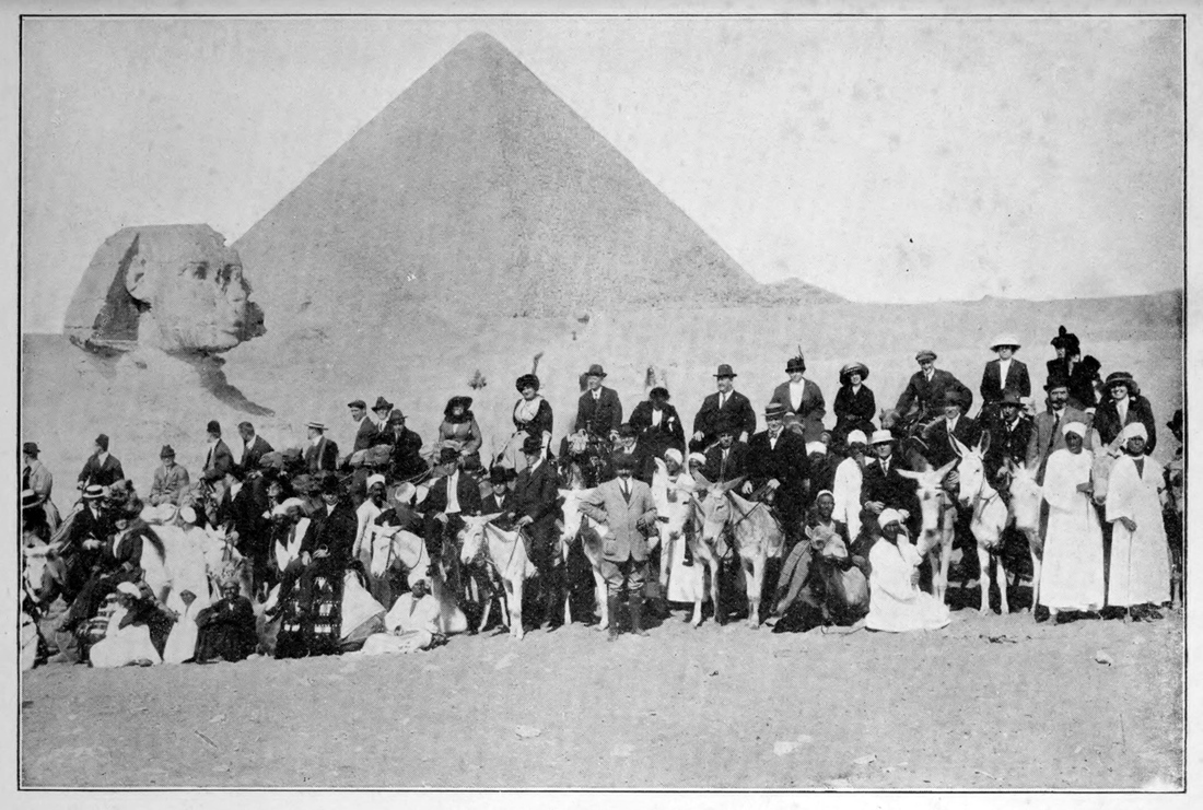 A tourist group from the White Sox and Giants stops for a photo in Giza, Egypt. Charles Comiskey and his wife can be seen on camels in the center.