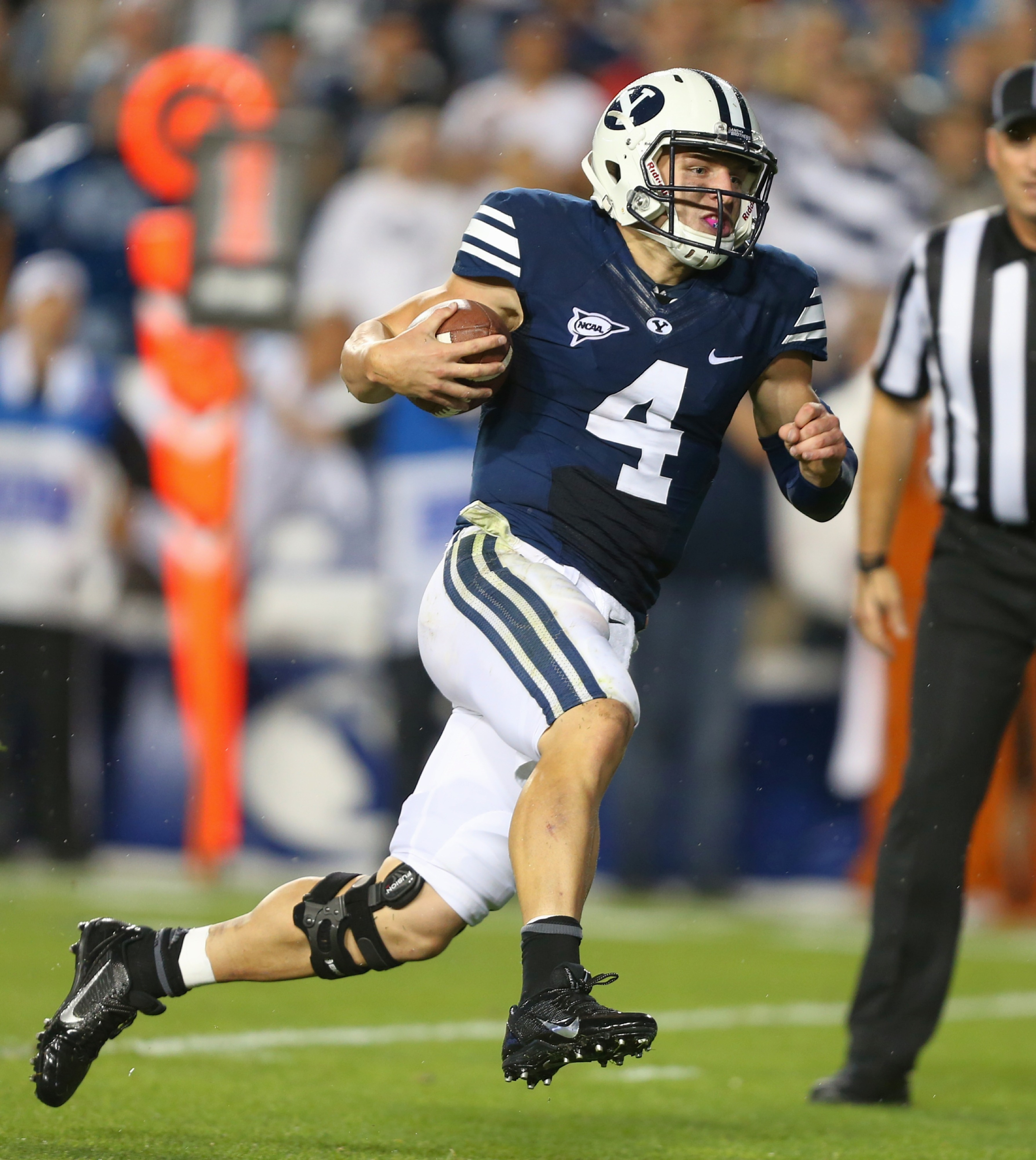 Taysom looking to run.
