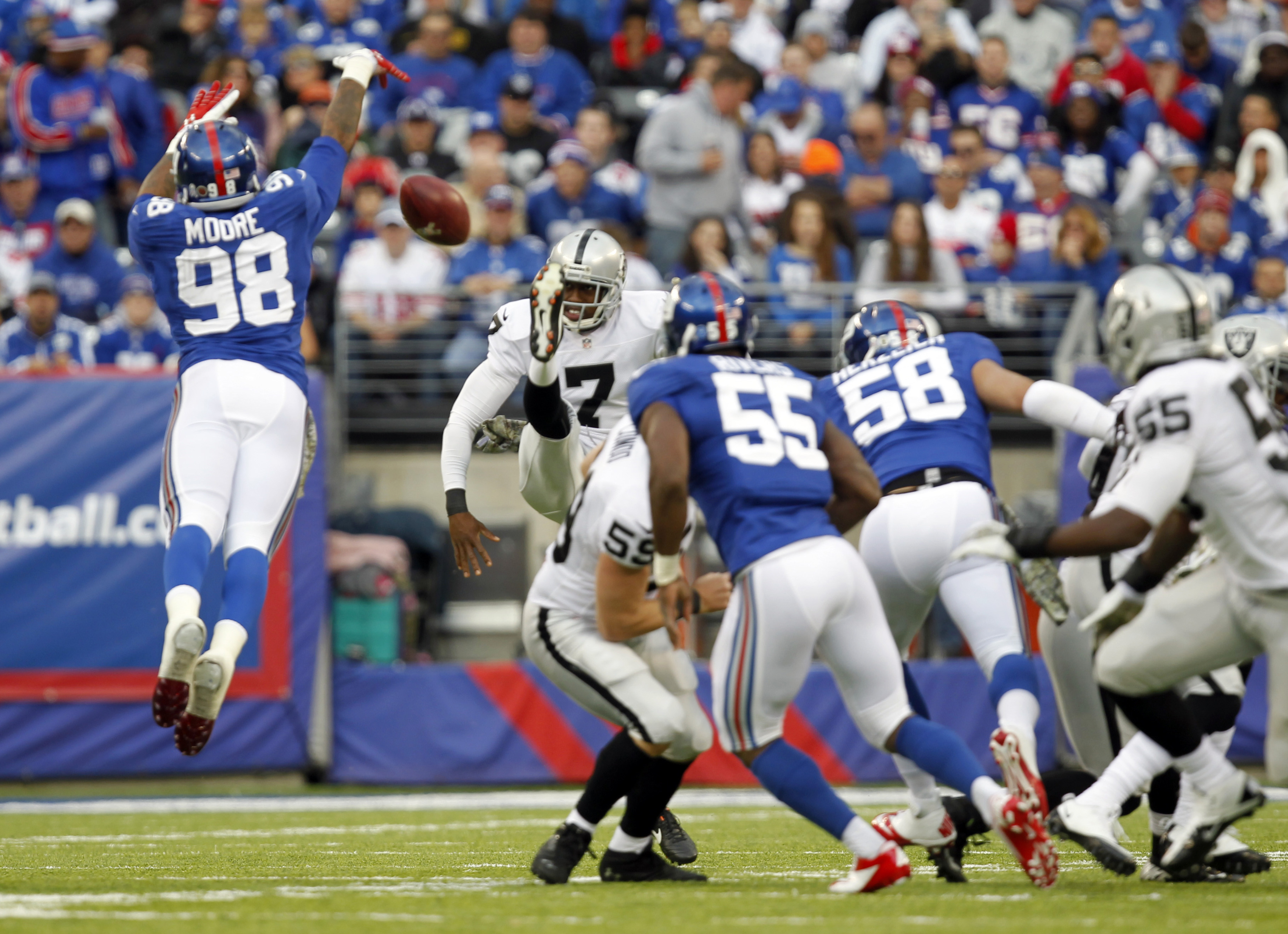 Damontre Moore blocks a punt against the Oakland Raiders