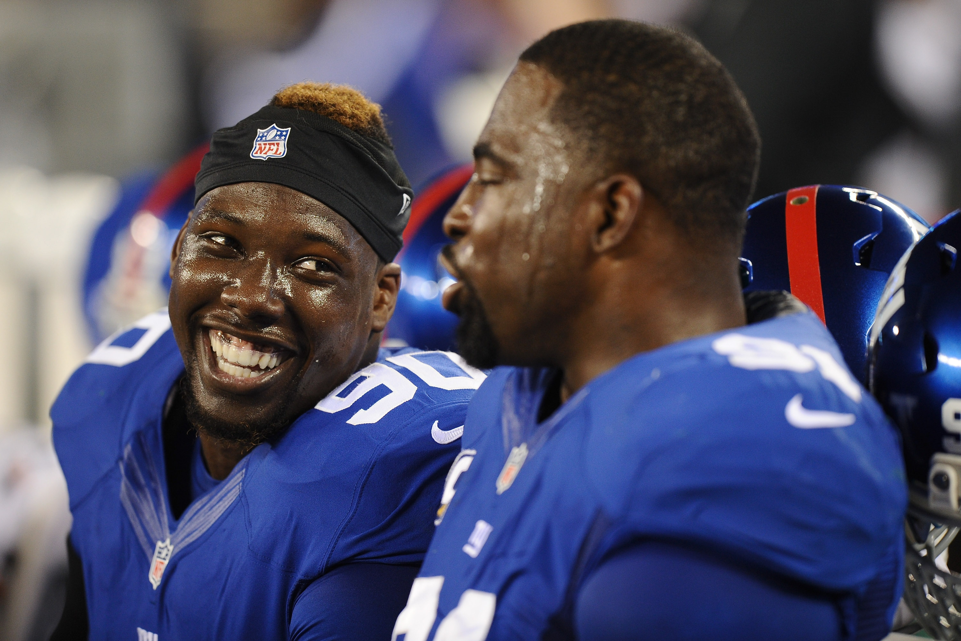 Jason Pierre-Paul and Justin Tuck talk in the fourth quarter