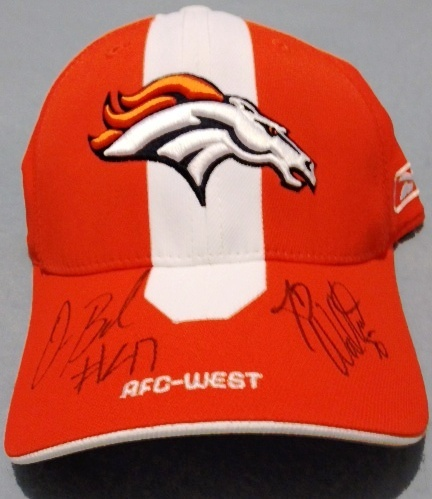 Omar Bolden and JD Walton autographed this hat at Training Camp