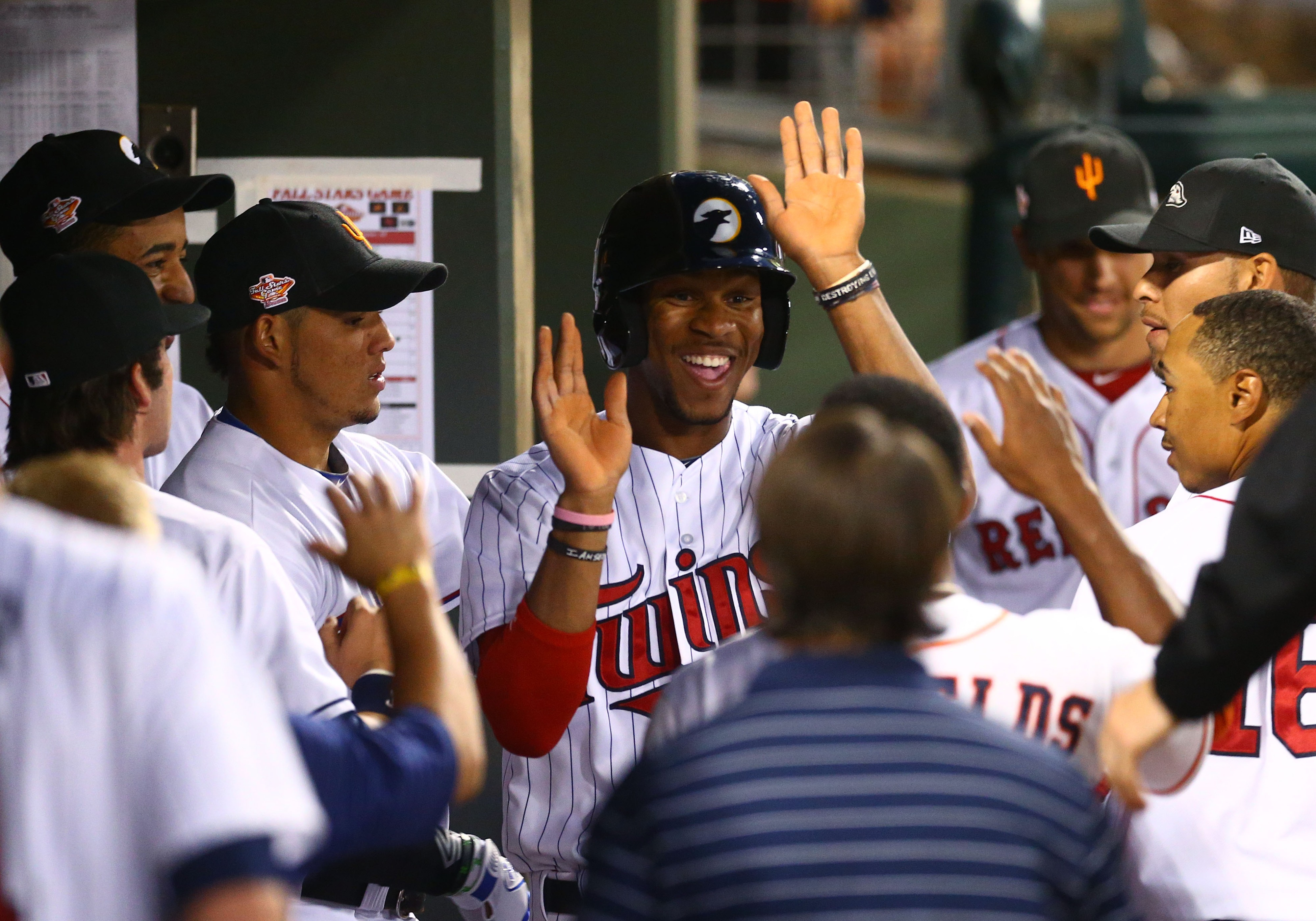 Everyone lines up to high-five Byron Buxton because he is The Best.
