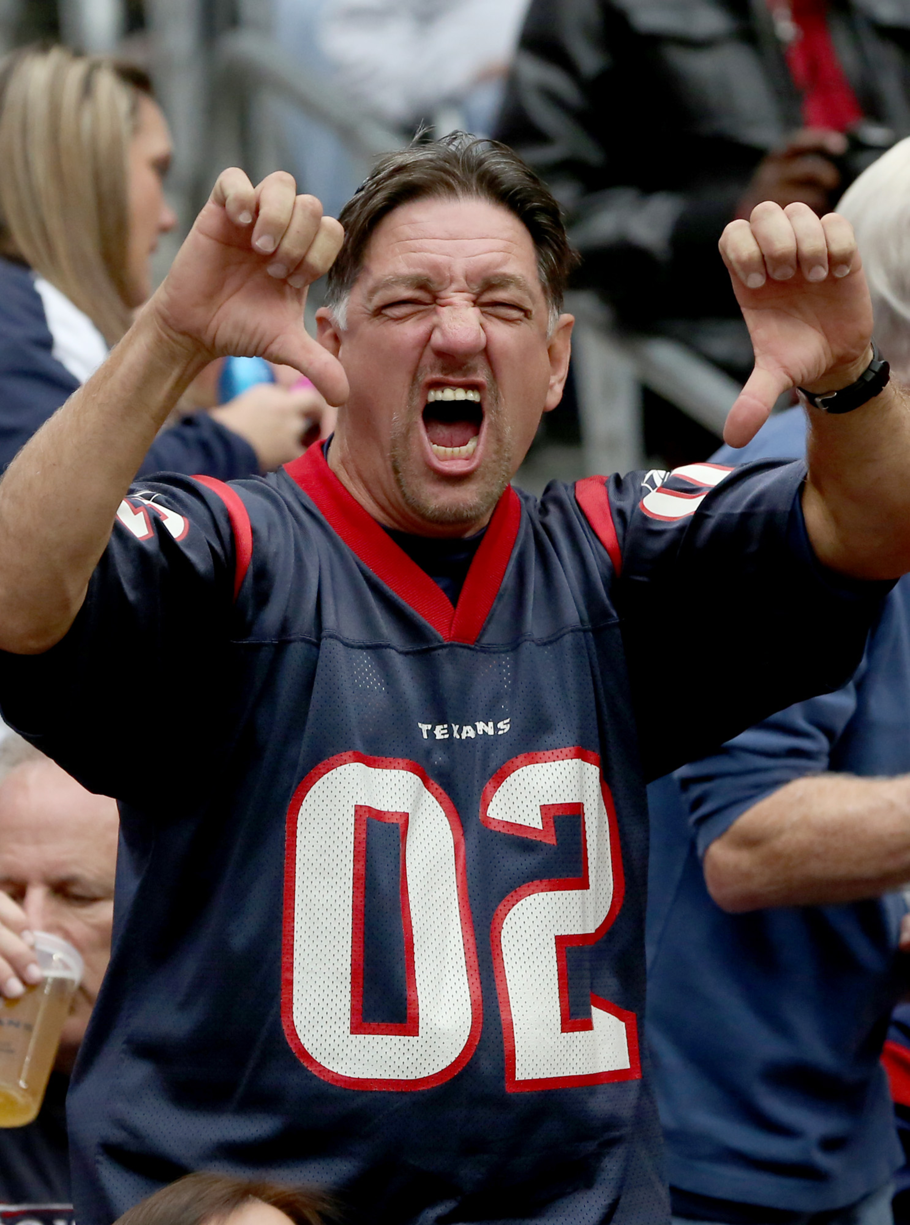 """Nothing says, """"I'm displeased with my football team"""" like two thumbs down and a sour visage."""