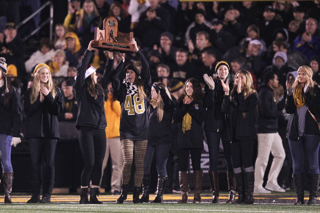 The volleyball team showed off its new trophy at last night's football game.