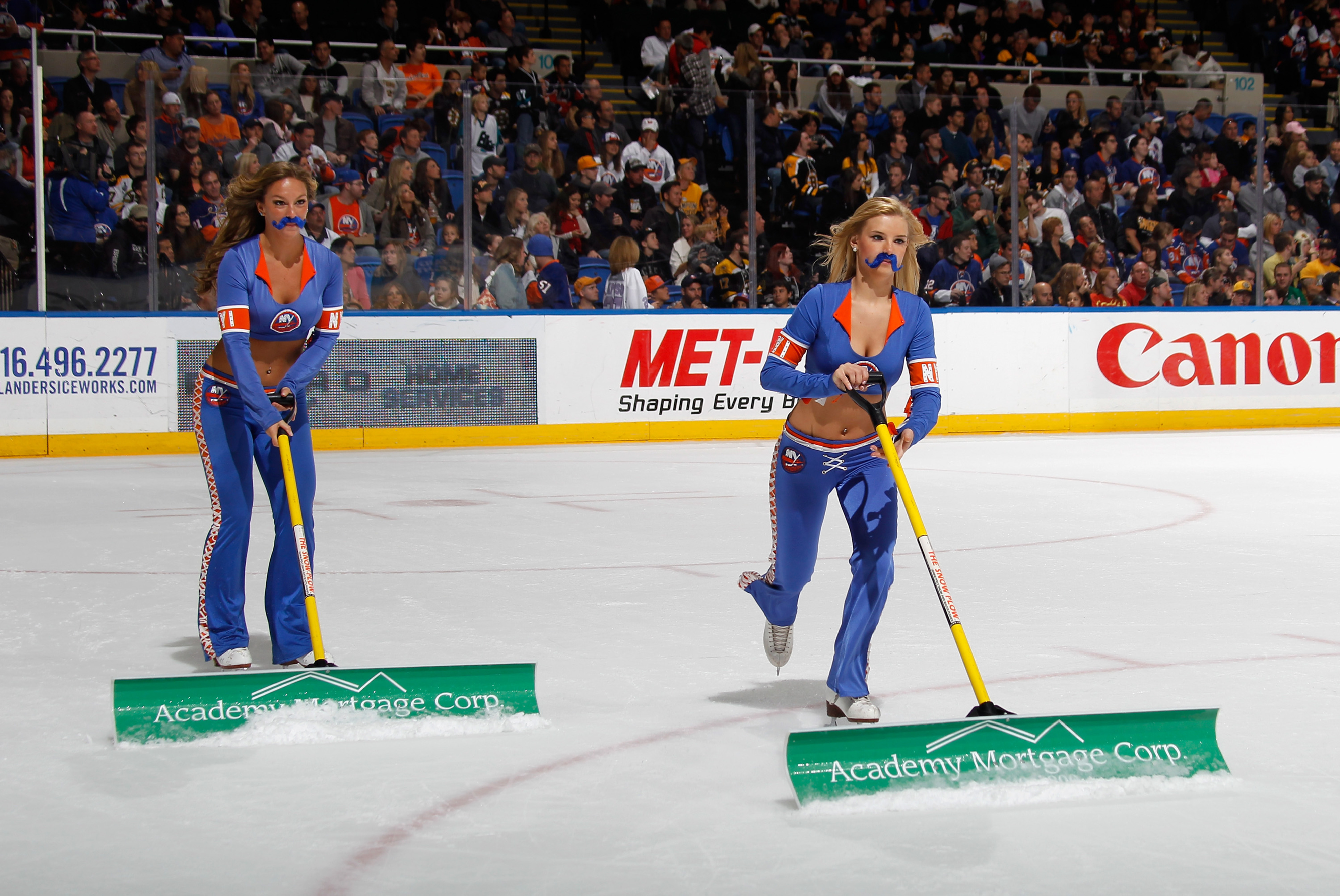 New York Islanders ice girls celebrate Movember by wearing fake mustaches during the game between the Isles and the Boston Bruins on November 2, 2013 in New York. (Photo by Bruce Bennett/Getty Images)