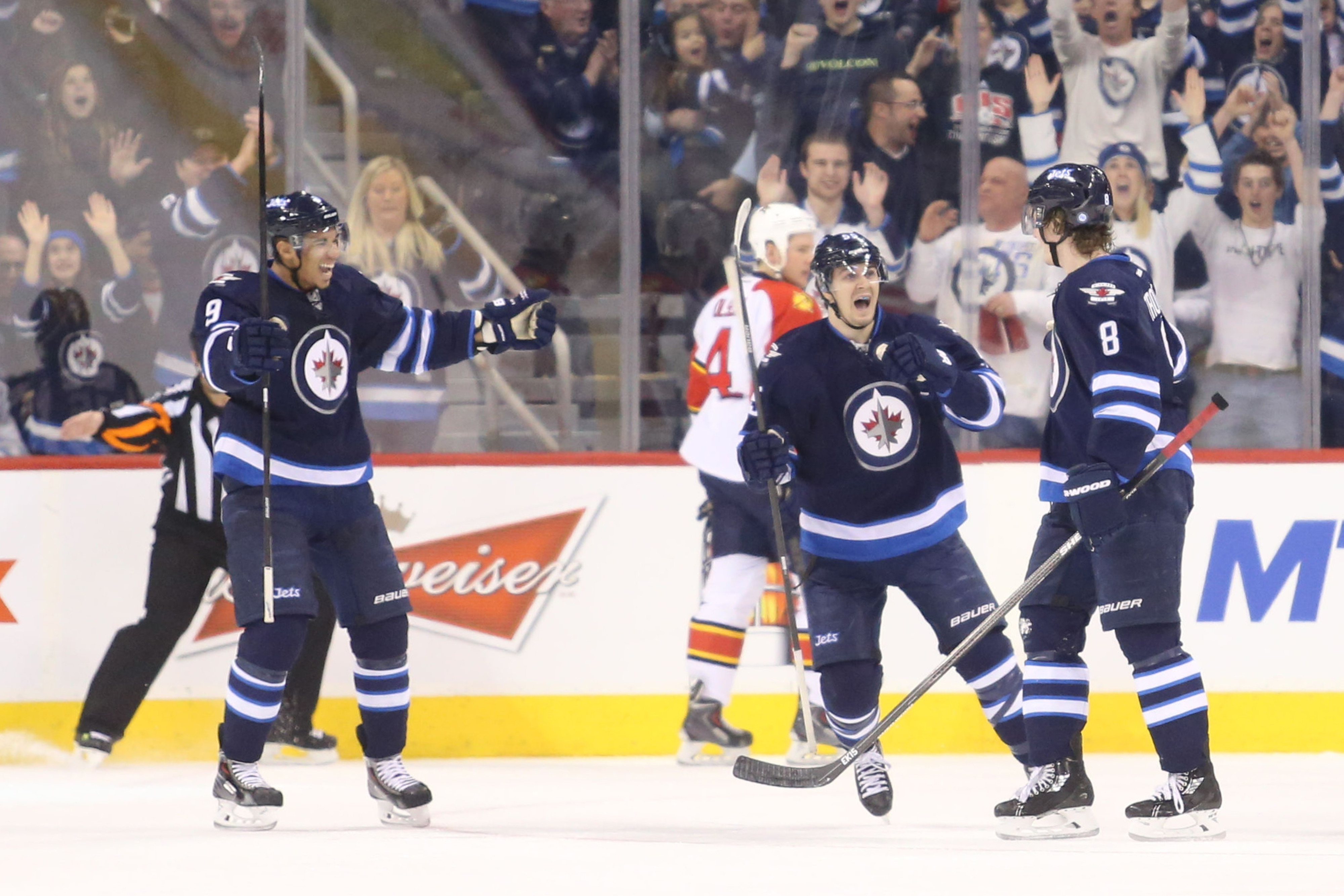 Kane, Scheifele and Trouba celebrate the Jets' first goal of the game.