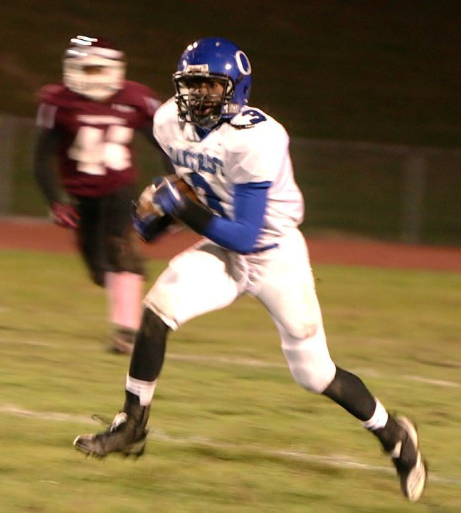 Clements runs with the ball at Oakcrest High School in New Jersey back in 2011.