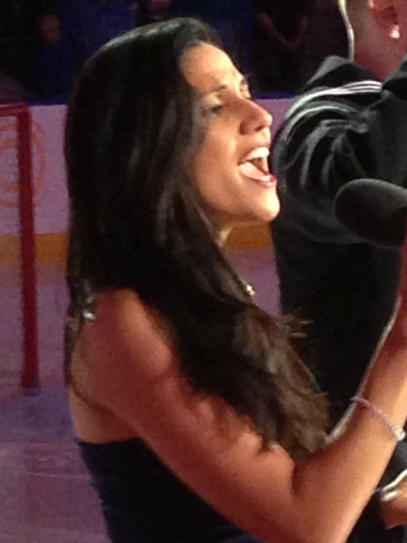 Vanessa Rodriguez of Opera Tampa performs the National Anthem  before the Lightning's game against the Rangers on December 29th.