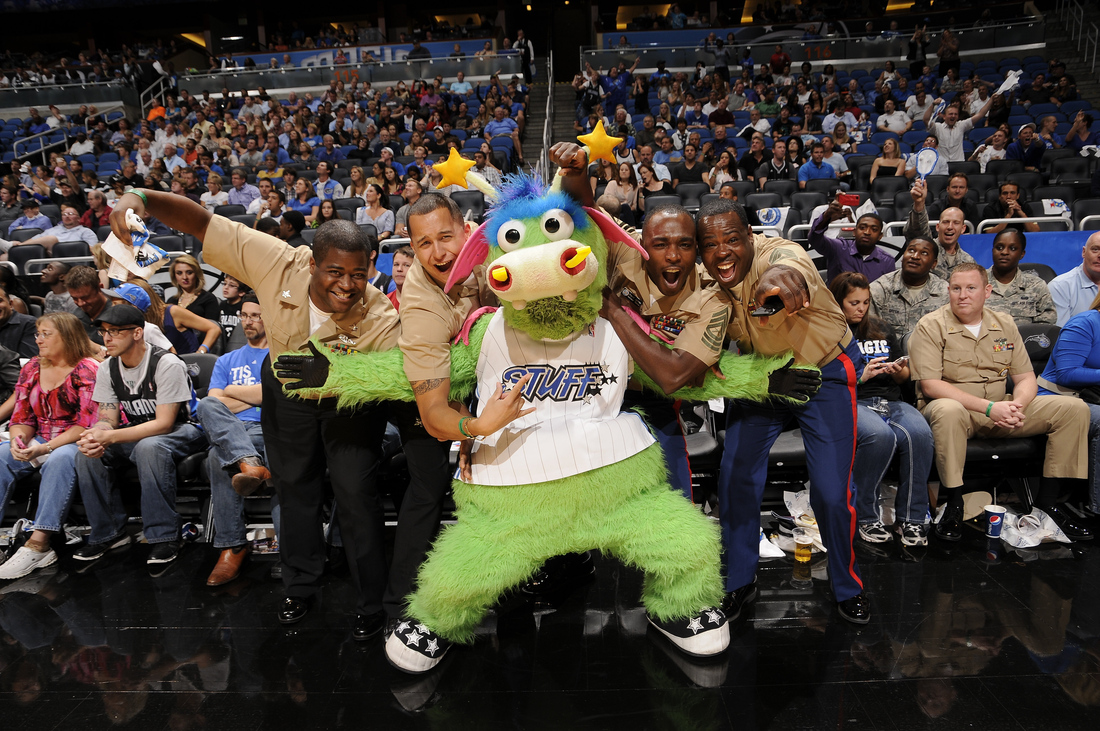 STUFF the Orlando Magic mascot poses with military personnel at the Magic game during Seats for Soldiers Night presented by Harris Corporation on November 4.