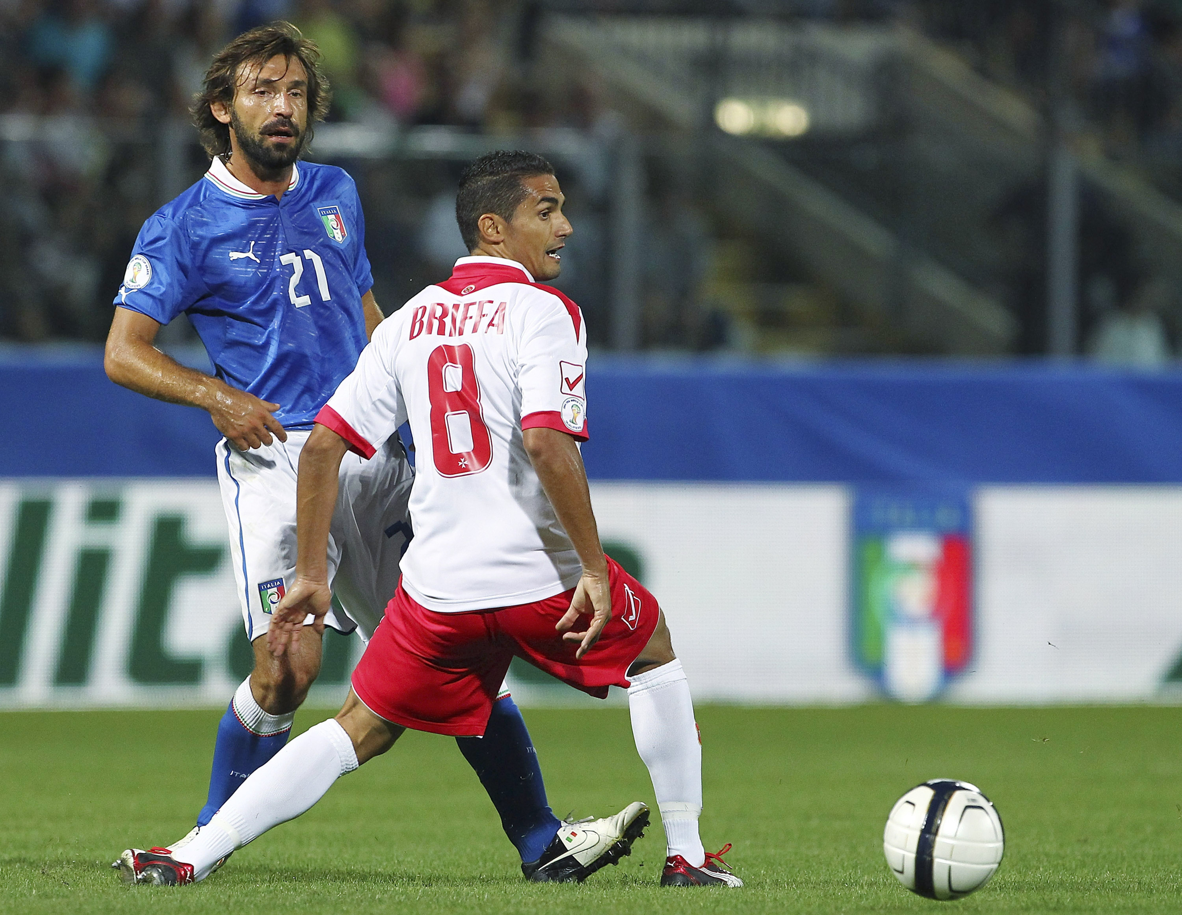 Valletta's Roderick Briffa playing for Malta against Andrea Pirlo and Italy in a World Cup qualifer.