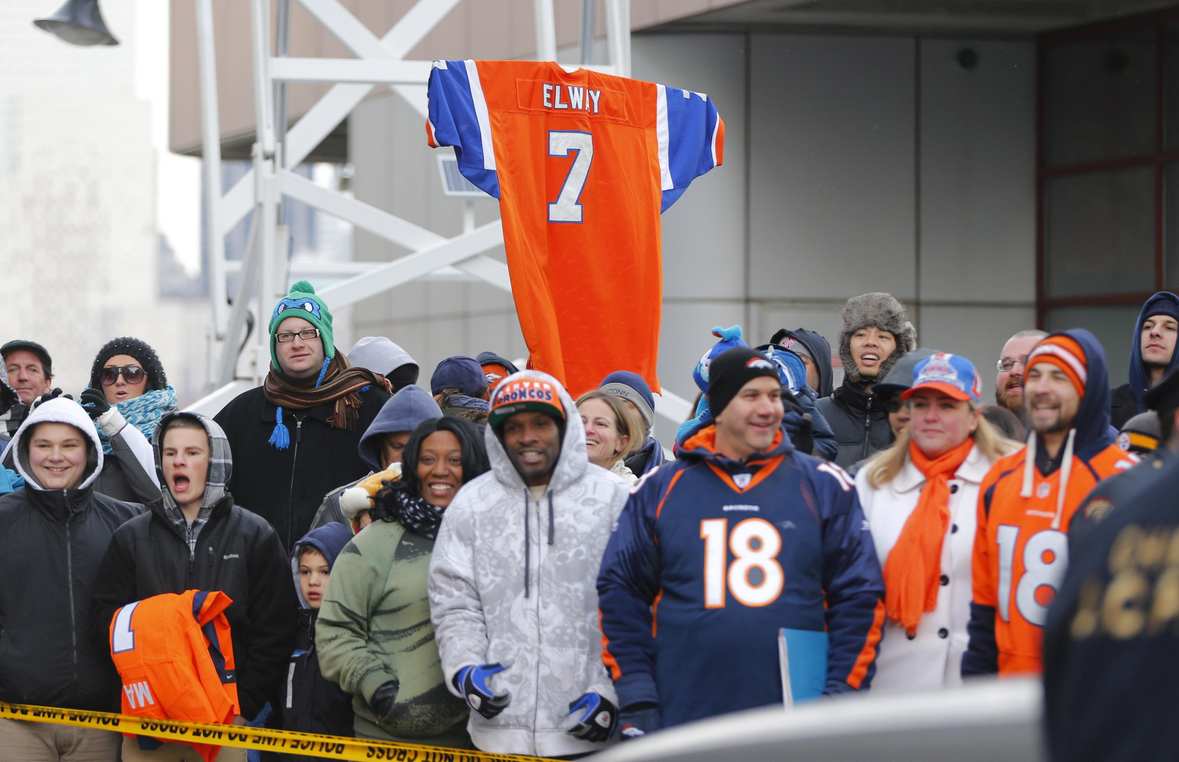 Broncos' fans await the arrival of their team on Sunday